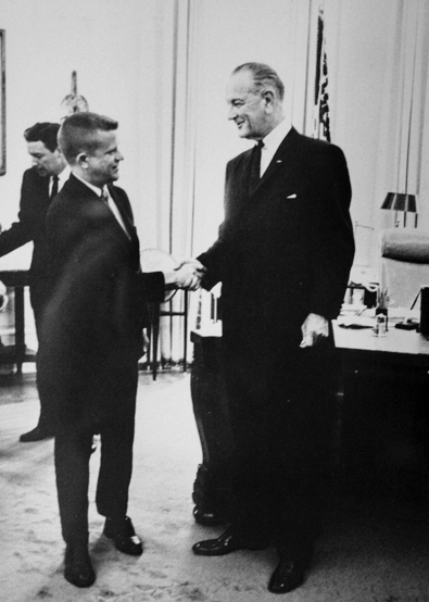 Robert Morgan serving as North Carolina's Attorney General shaking hands with President Lyndon B. Johnson