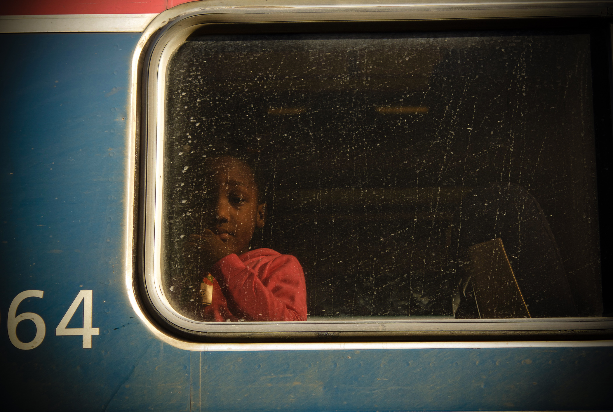Girl looking out Southbound train window, Rocky Mount.