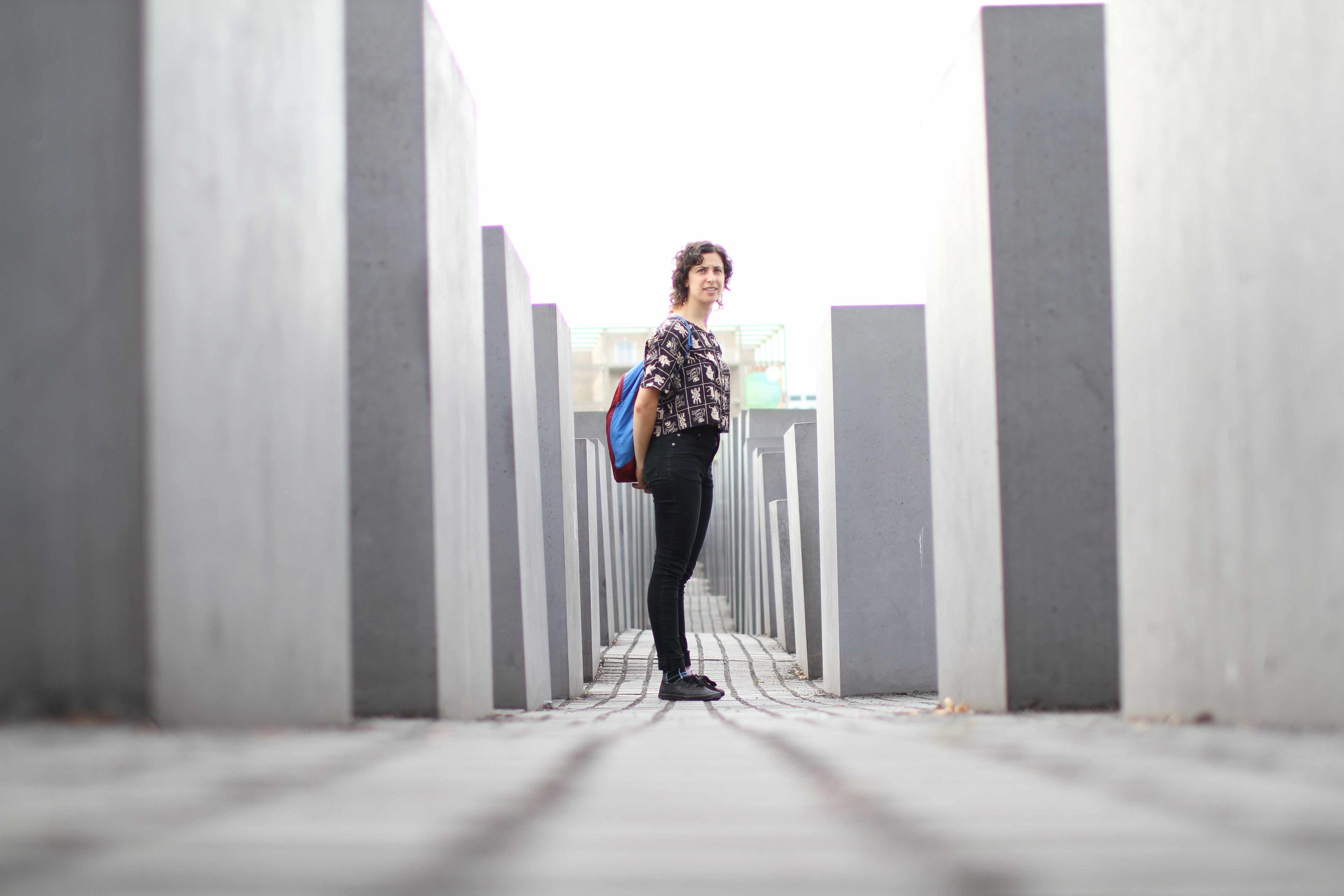 Standing in the Memorial to the Murdered Jews of Europe in Berlin. Meant to mimic grave stones, and erected in unending rows, you are forced you to move through the columns alone, meditating on the inconceivable horror of the Holocaust.     —