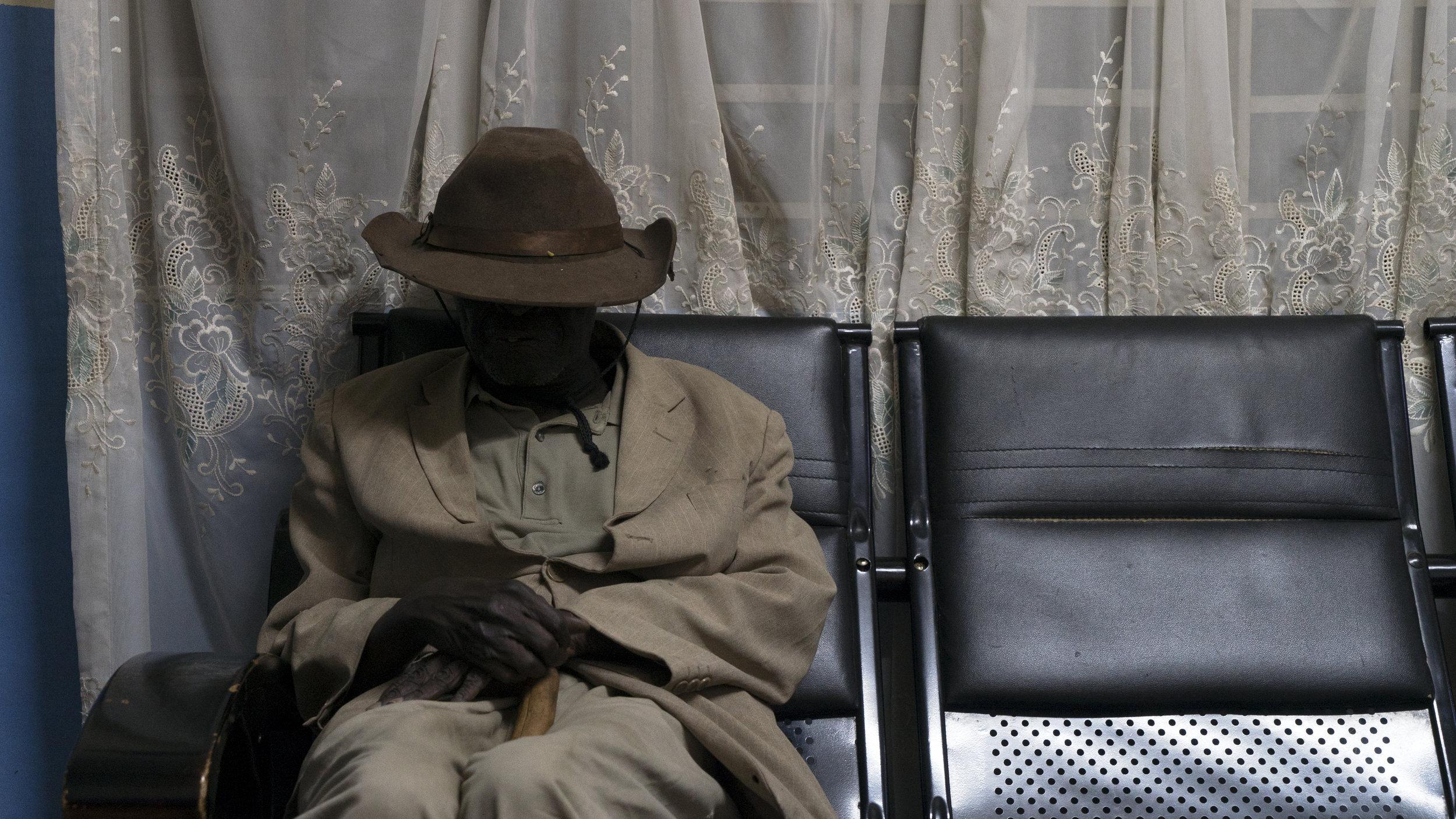 Olima waits at the radio station