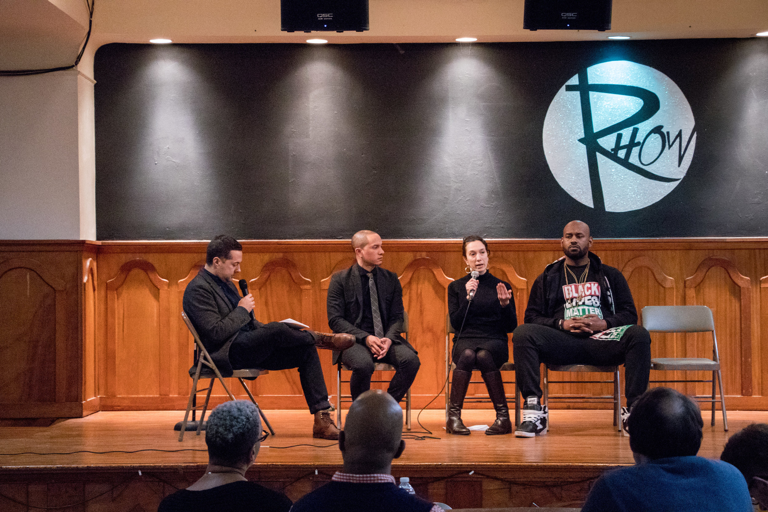 Mika Dashman speaking on a panel at the Christian Community Development Association's Locked in Solidarity event, February 2018