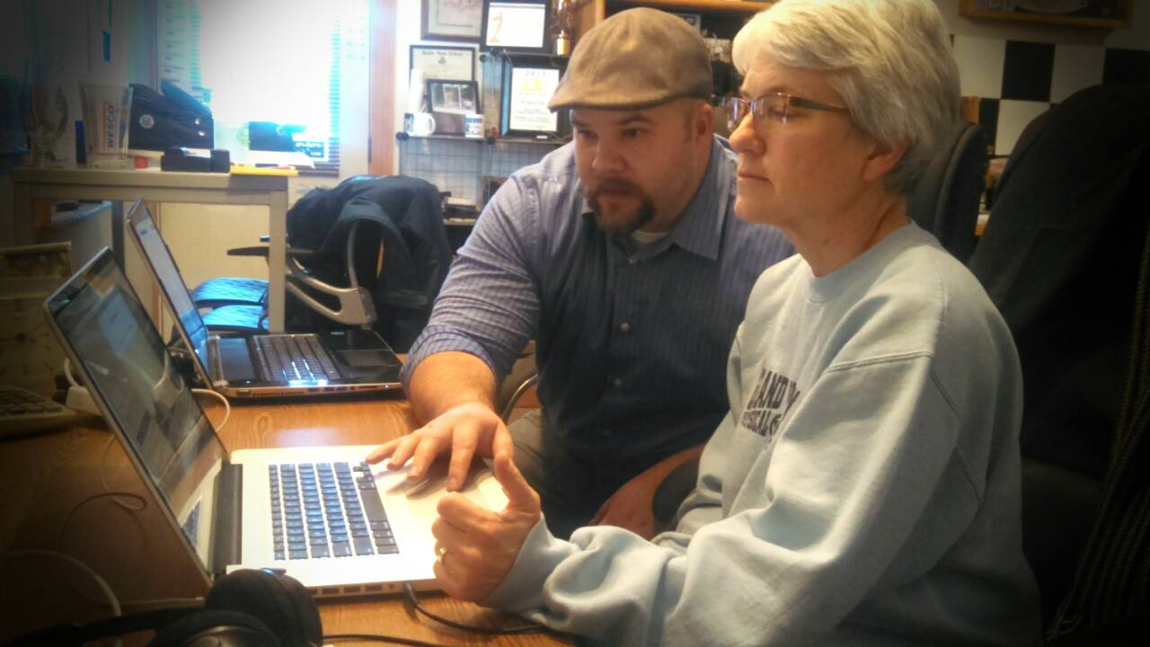 Johnny B Allen providing one-on-one training to Lynn Benson at DW Video & Multimedia, in Howard City, MI