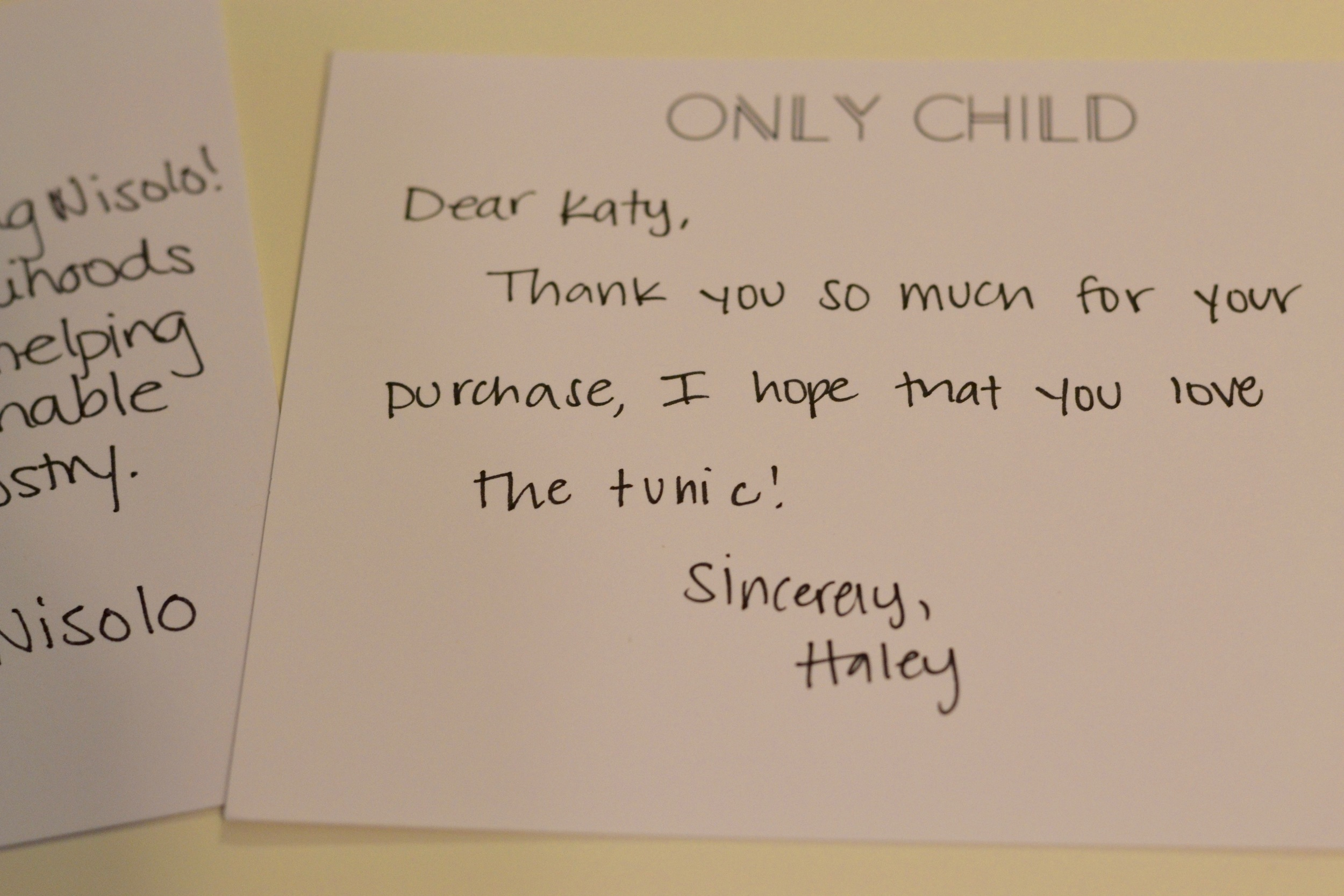 Katy saves the handwritten notes that often accompany purchases from a fair-trade company.