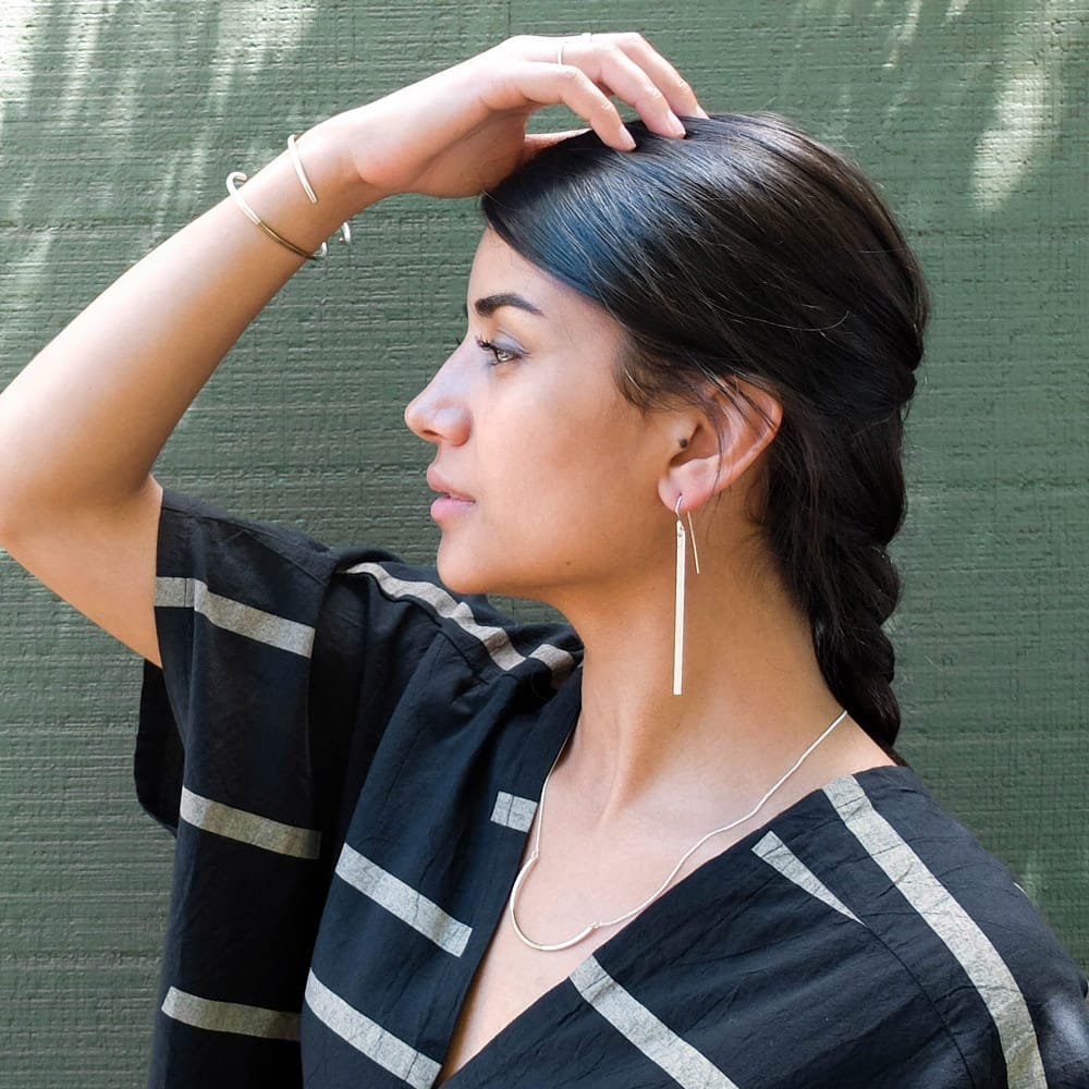 betsy-and-iya-koa-svasta-earrings-&-modu-cuffs.jpg