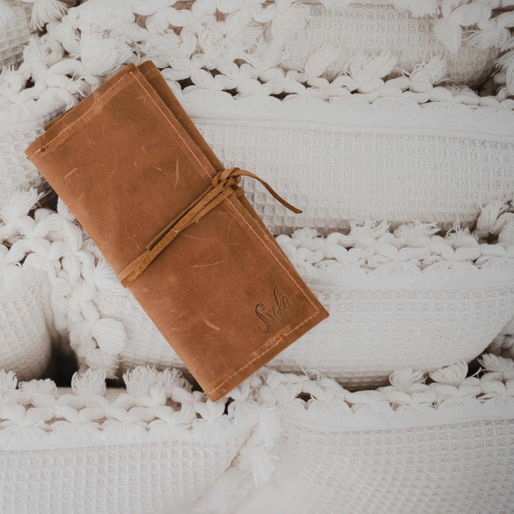 LEATHER JEWELRY ROLL | $59 - Keep your favorite jewelry safe and tangle-free in this Leather Jewelry Roll. The oiled caramel leather will grow even more beautiful over time. This is the perfect piece for gals on the go!