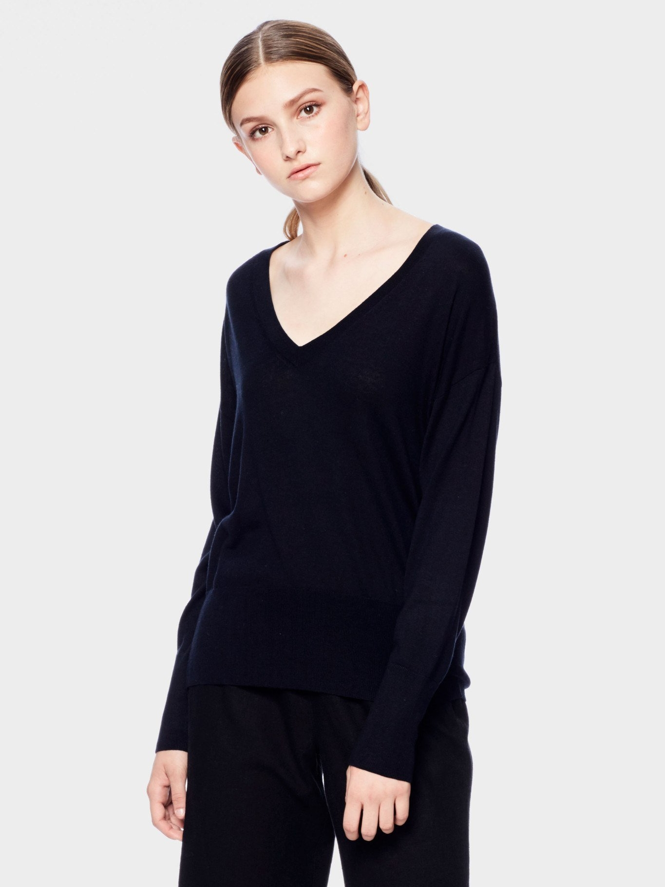 CASHMERE SWEATER | $105 - A luxury blend of Cashmere and Silk defines SiiZU's Inanna sweater as a must-have wardrobe basic.It features Deep V neckline, drop shoulder line, and high-low hem. Sustainably made and ethically manufactured, this sweater is sure to please!