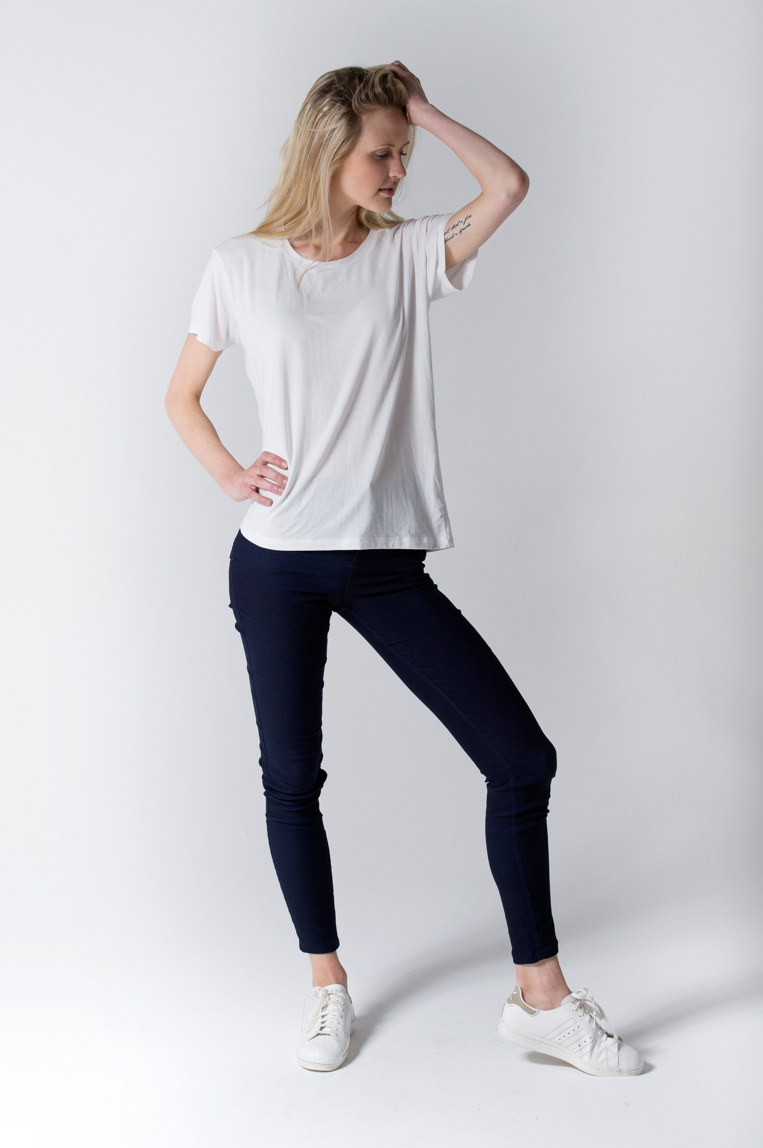 WHITE TEE | $54 - This super soft, slinky tee will be a workhorse with jeans, shorts, or layered under a blazer to the office. The elongated body allows you to wear the tee with leggings for coverage or tuck it into jeans or a pencil skirt.