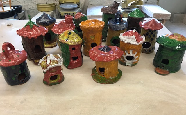 Clay Birdhouses made by residents of Port Chester at the Clay Art Center.