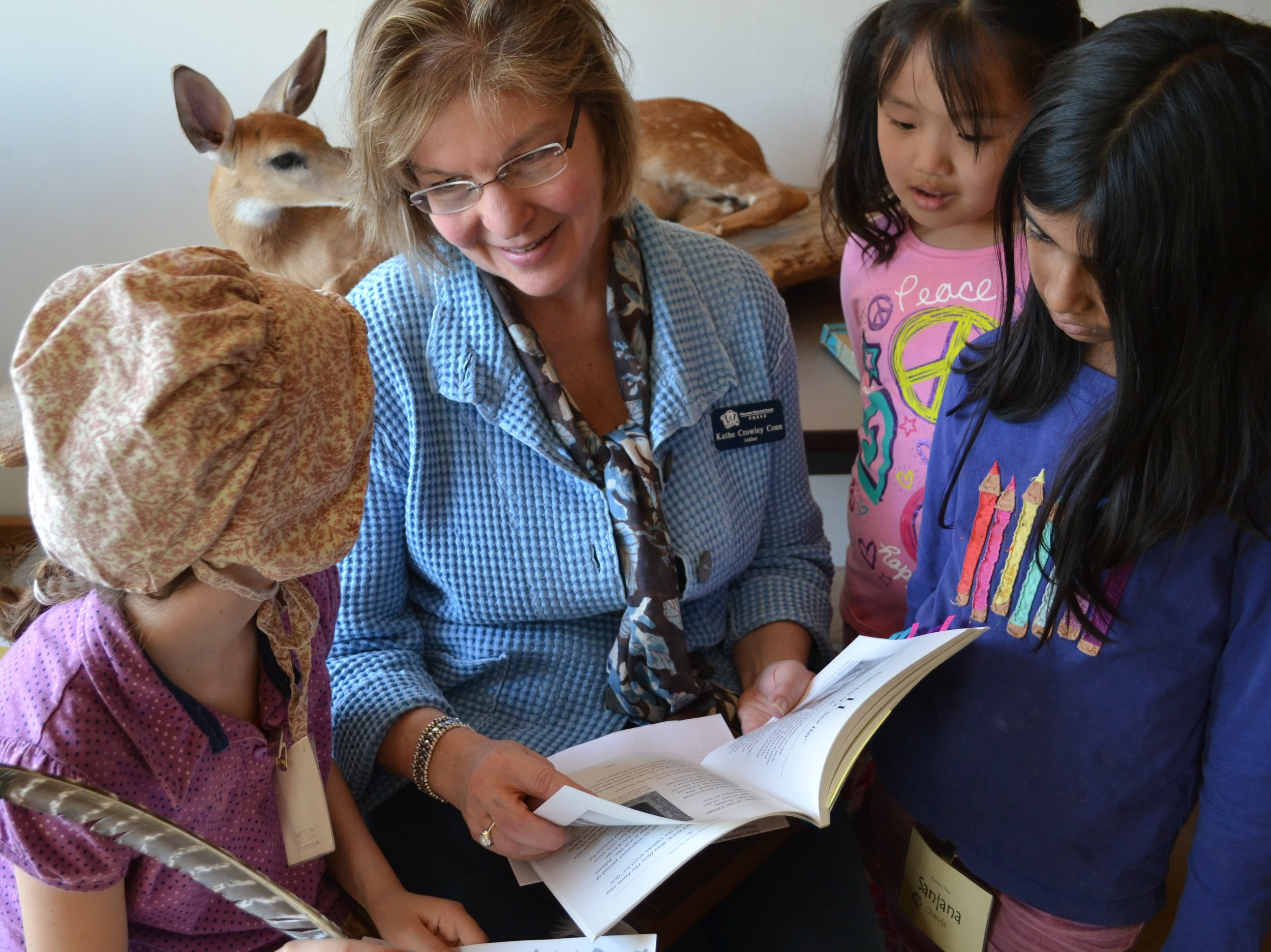 """Book launch event at the Aldo Leopold Nature Center. """"Pioneer"""" children are captivated by Juliette's tales. The children had great questions and insights about pioneer life and also wrote letters about their day's adventures the 'old fashioned way', just like Juliette!"""