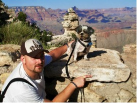 Reggie at Grand Canyon with my husband.