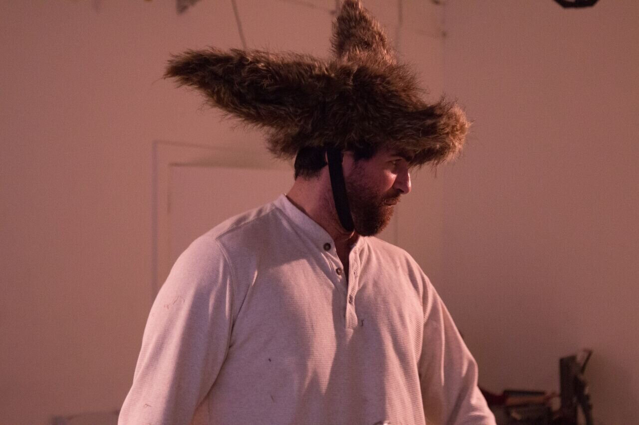 Here the character Nick Bottom wears a donkey head crossed with a modern baseball cap. Photo credit: Matthew Echelman