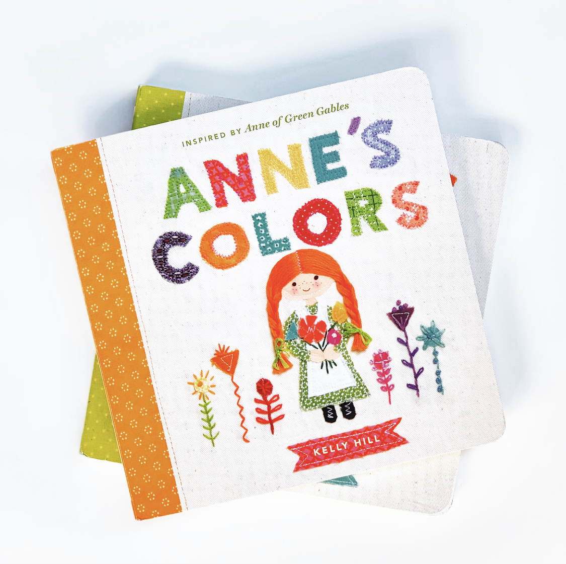 Anne's Colors  teaches colors ranging from pink to blue to white to green. Each color is displayed with a charming companion illustration on the opposing page.