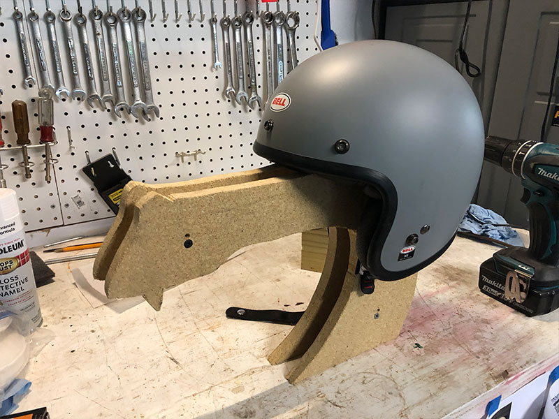 "Two sides were cut and screwed together. Separated by a 1"" block of wood in 3 locations to create the correct width of the frame. It looked pretty good at this point with the helmet on. It was starting to come to life."
