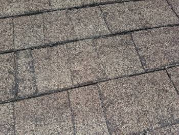 Old deteriorated shingles observed at a Houston home inspection