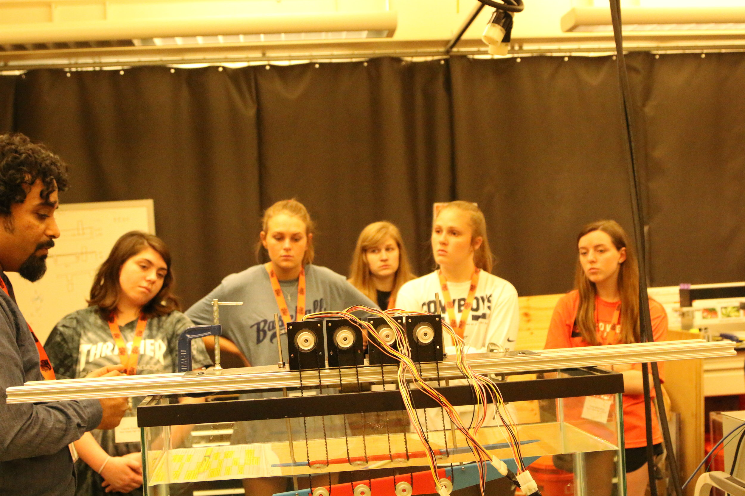 "Students watching a demonstration of the ""krillbot"""