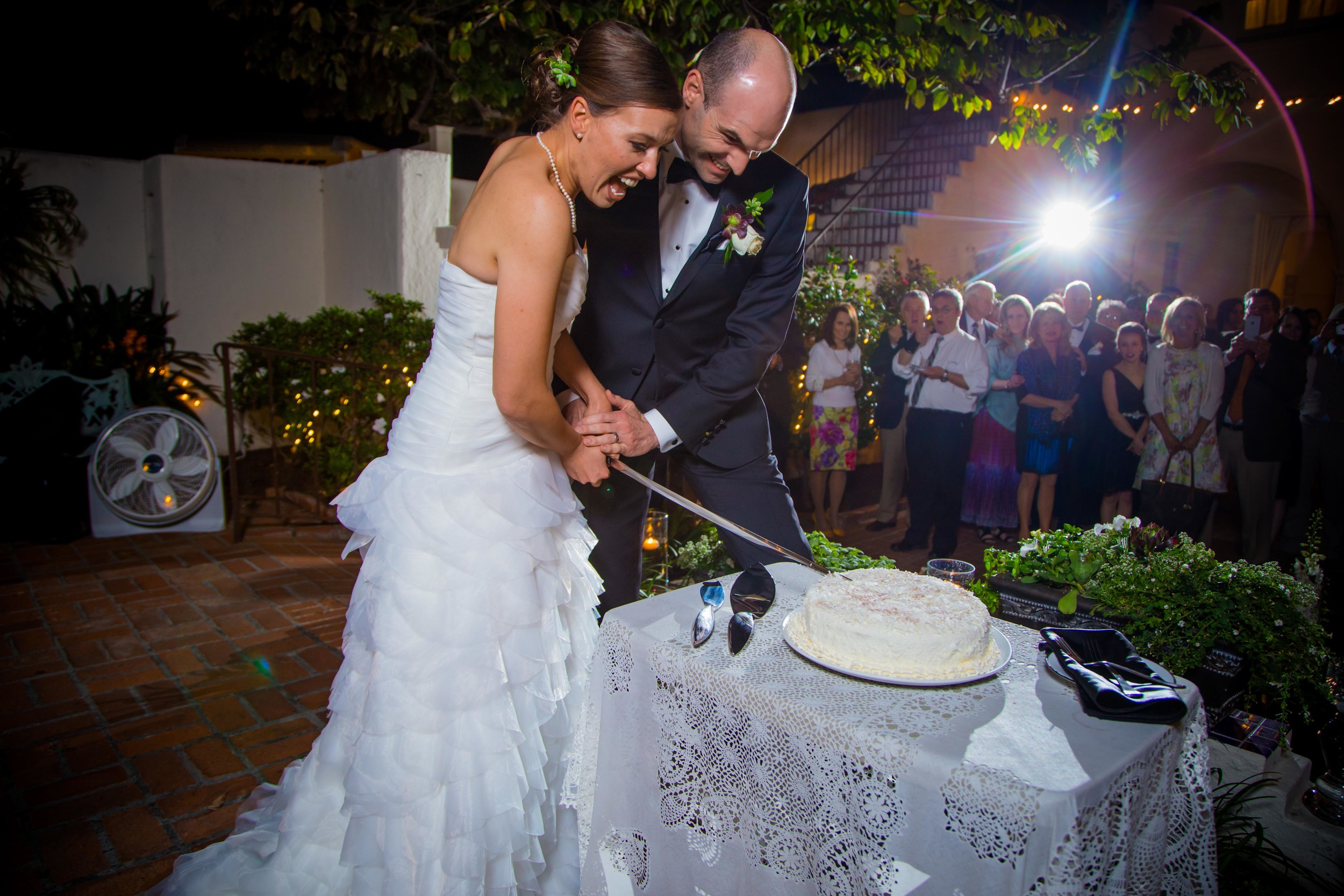 Cutting the cake with a sword... awesome.