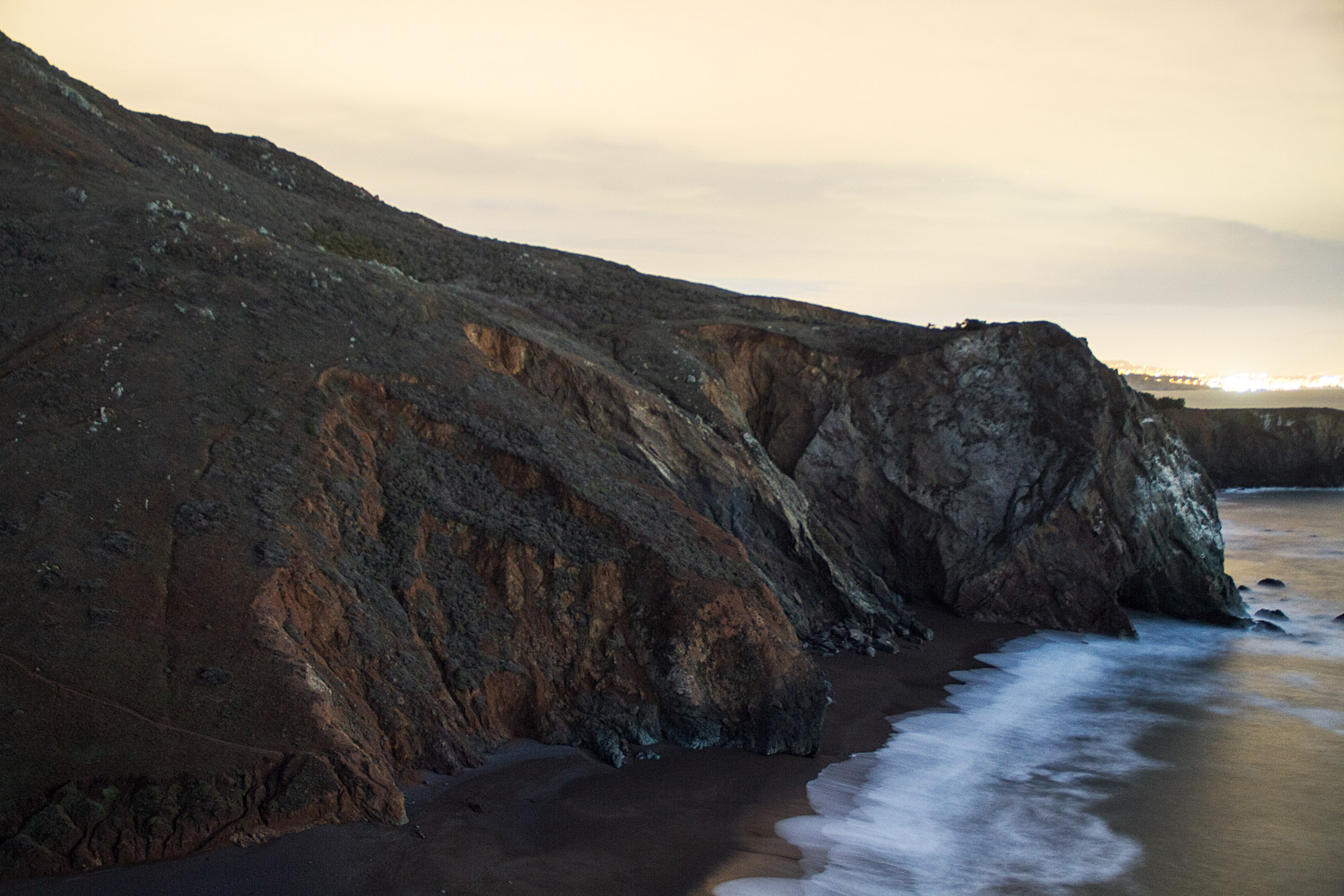 cliff at tennessee valley beach at dusk.jpg