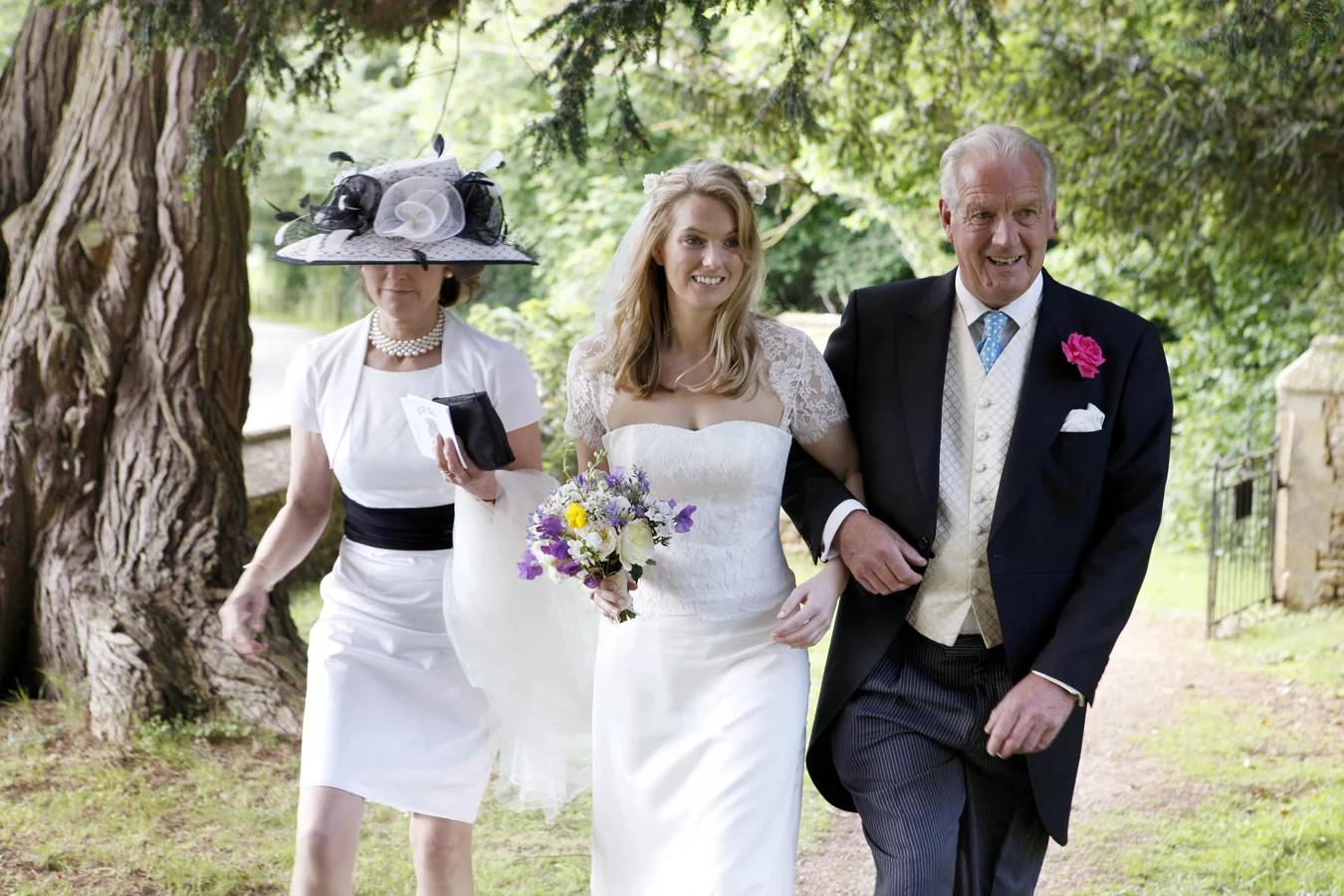 Camilla wears Bespoke .