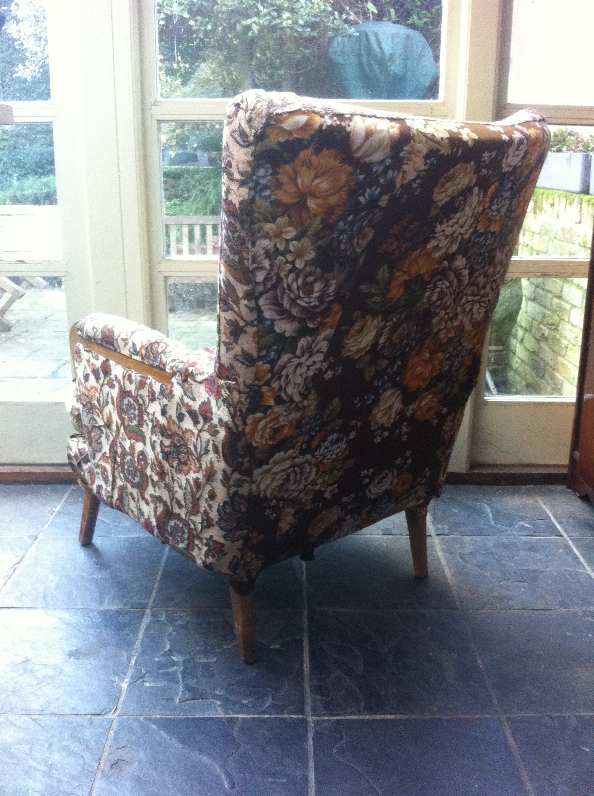 Here is an armchair which I'm going to reupholster for  Threads  Vintage, Peckham.  I like the way they've used different florals on the front and back but whoever tried to upholster this before seemed to have no previous experience!