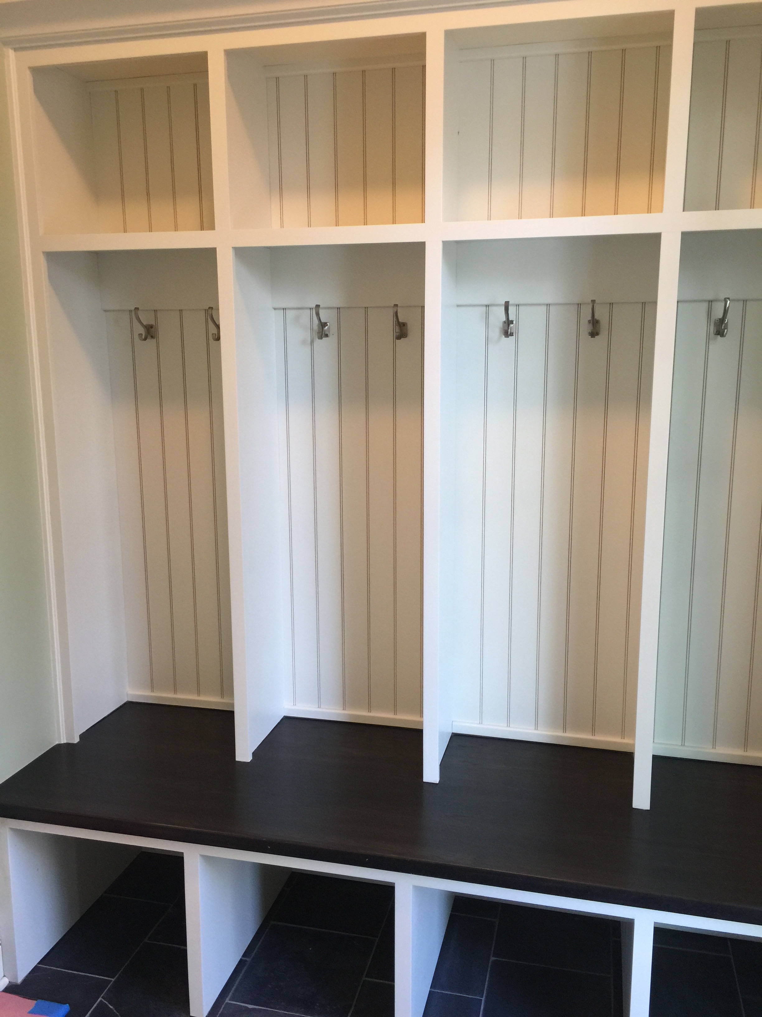 Your typical builder-grade, new construction mudroom.