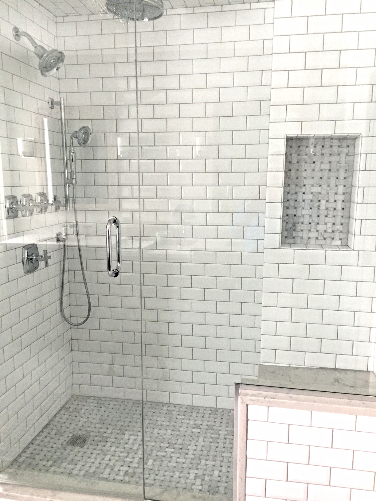 The frameless glass, bench, and alcove bring the shower into the 21st century.