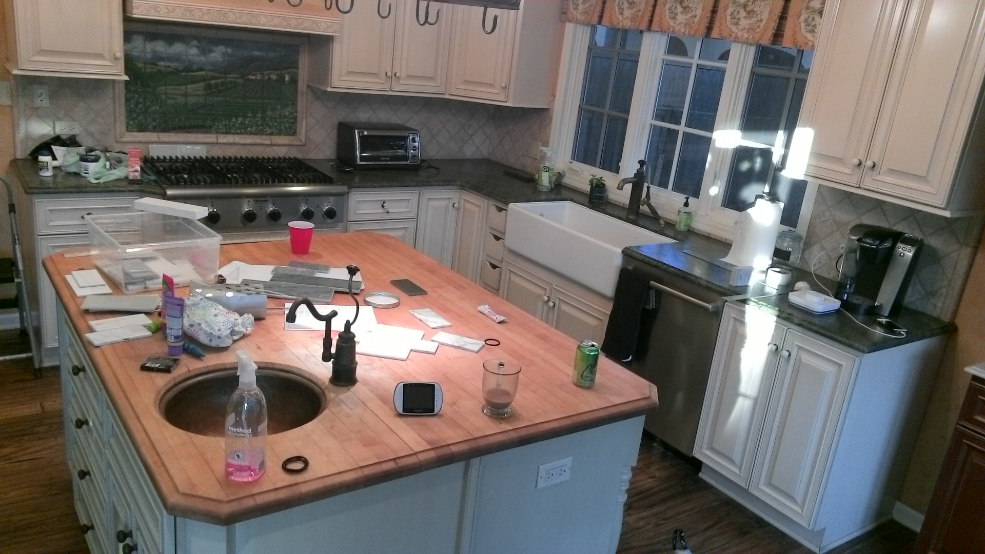 It was time to say addio to the Italian kitchen, including the pastoral backsplash over the cooktop.
