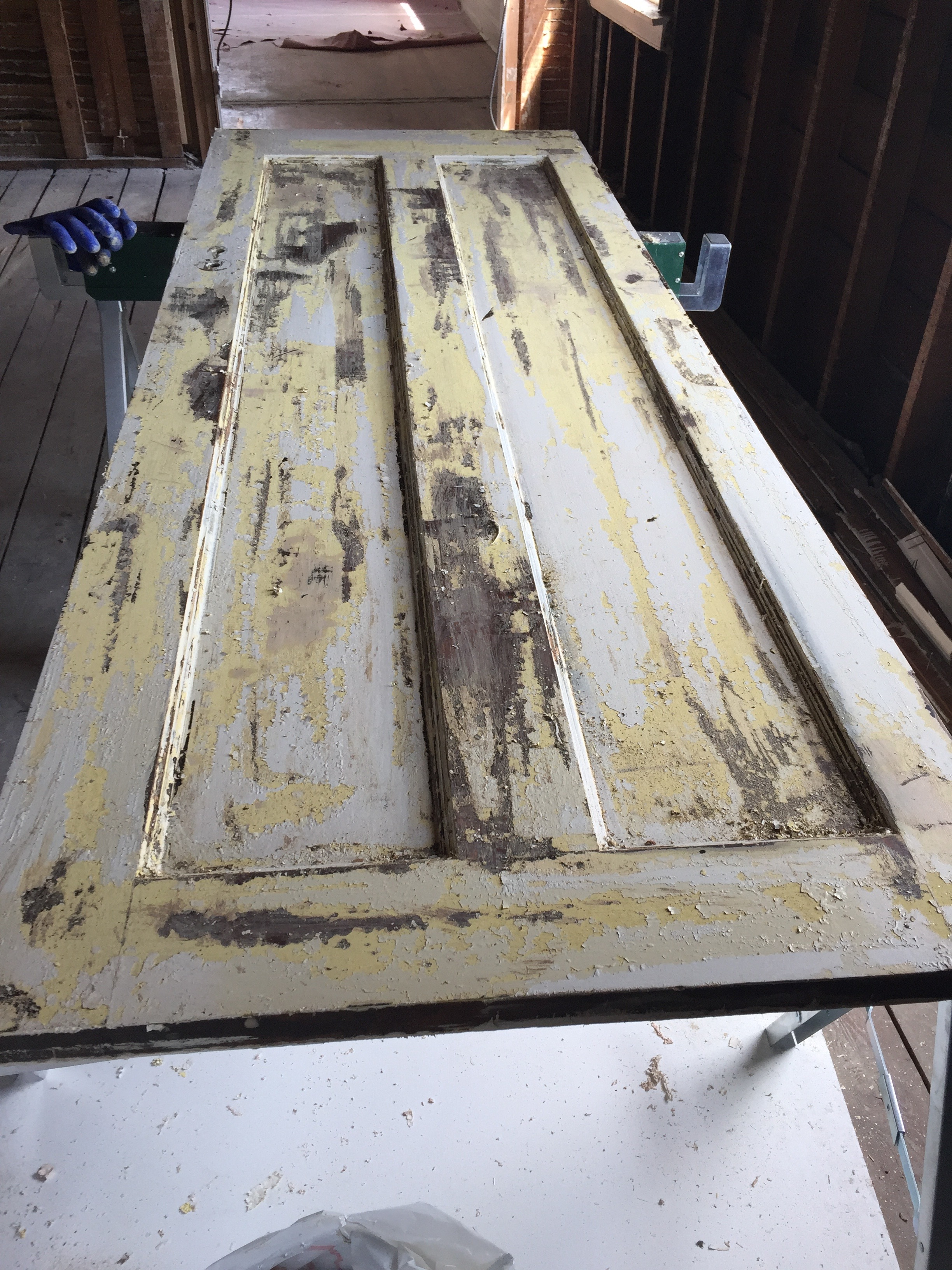 We decided to preserve as many of the original solid wood interior doors as we could. Some were in rough shape, and all of them needed to be stripped, sanded, and repainted.