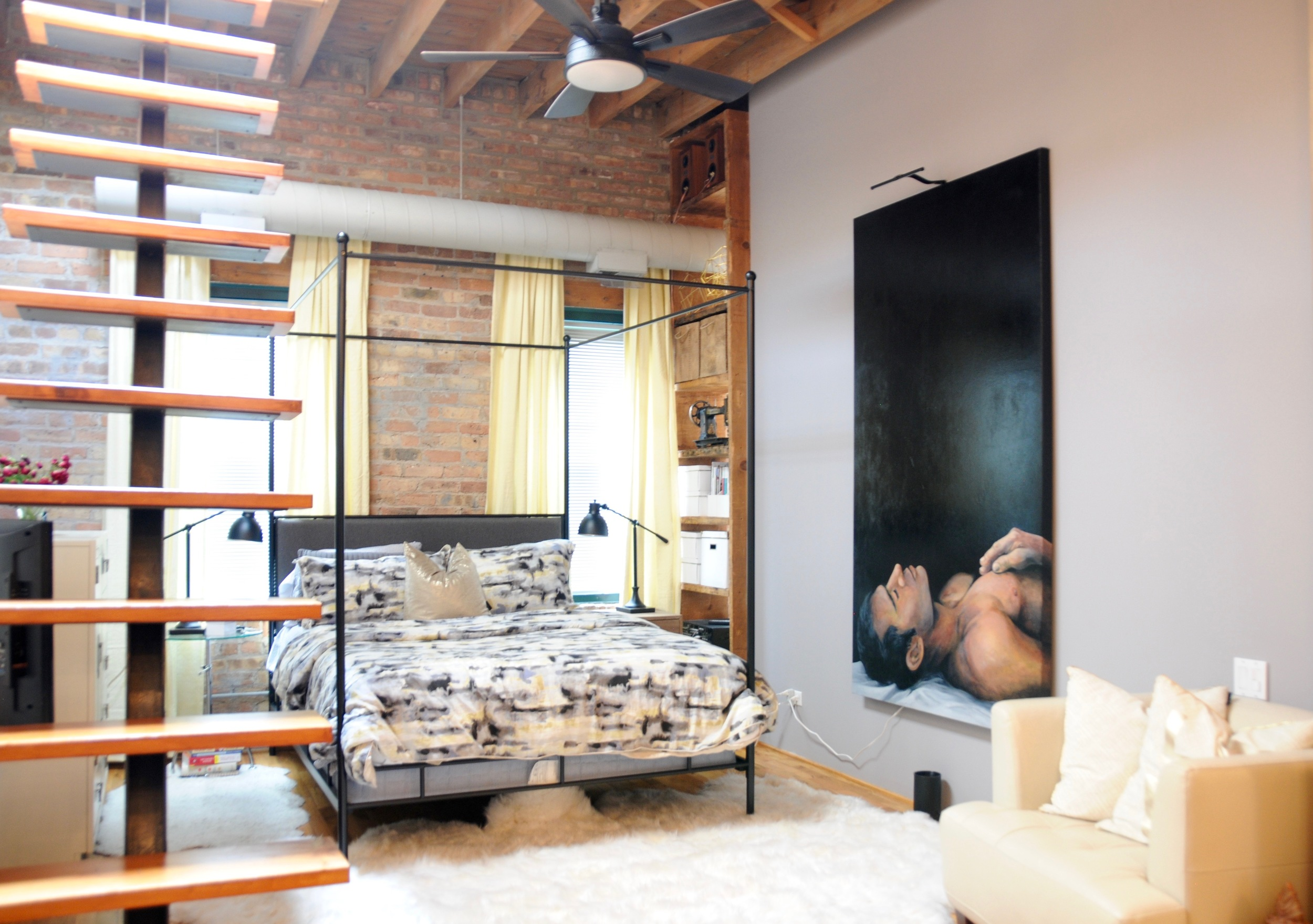 The owners bedroom with floating stairs to the clouds and an unobstructed view of Chicago.