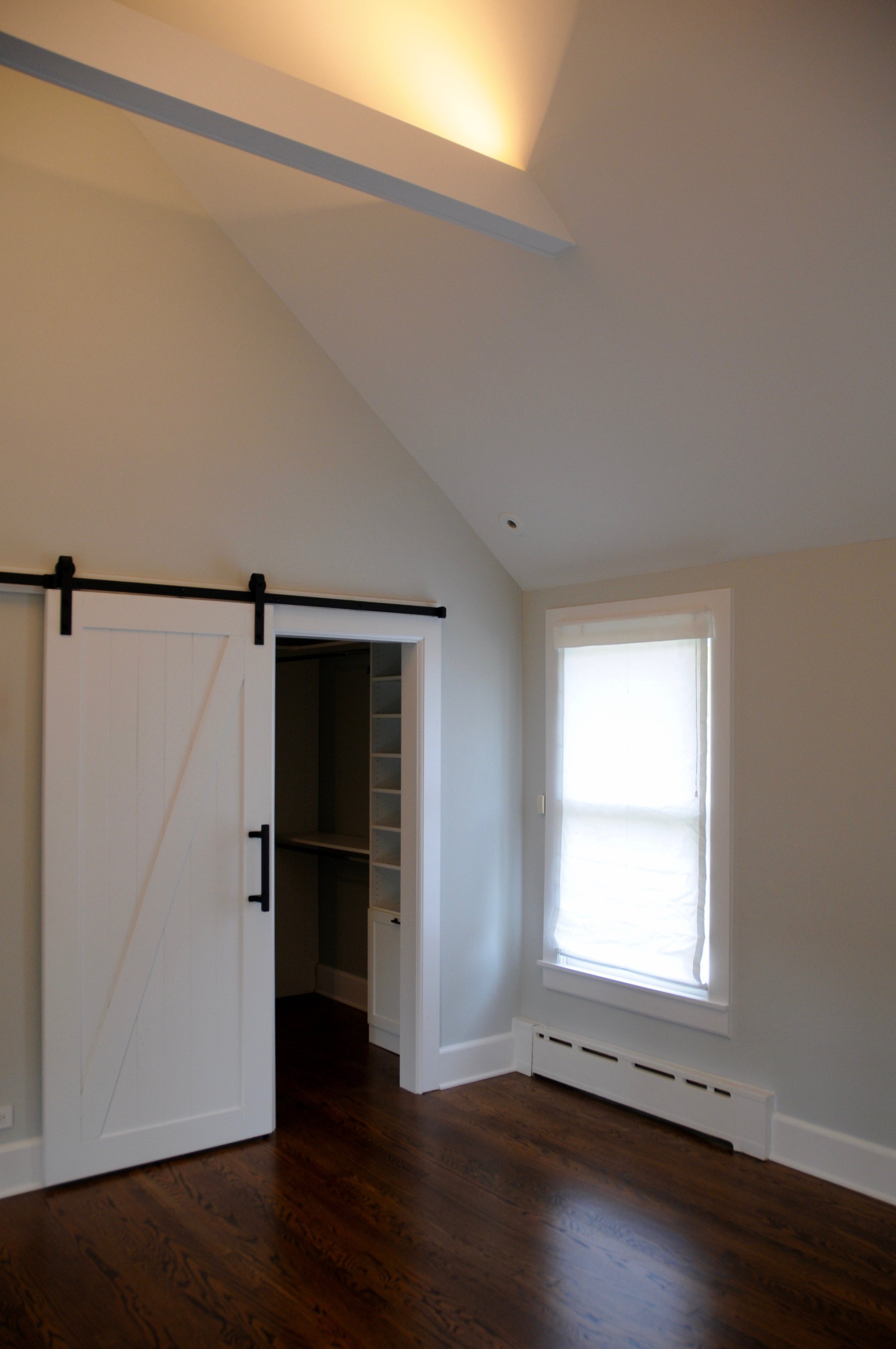 LED lighting recessed into the beams illuminates the tall ceilings with up-light.