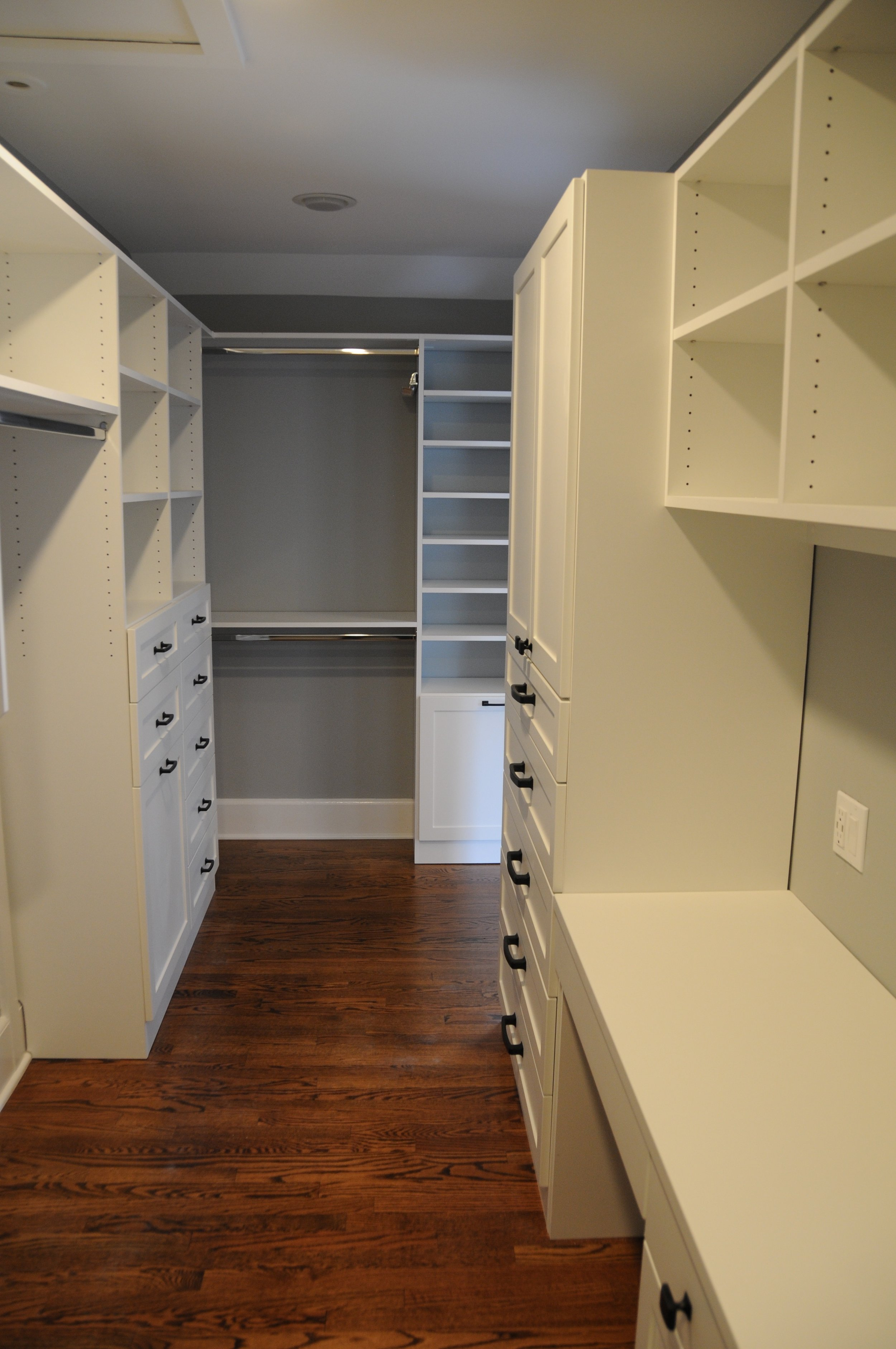 The new closet with built-ins by  Perfection Custom Closets includes a desk with under-cabinet lighting.