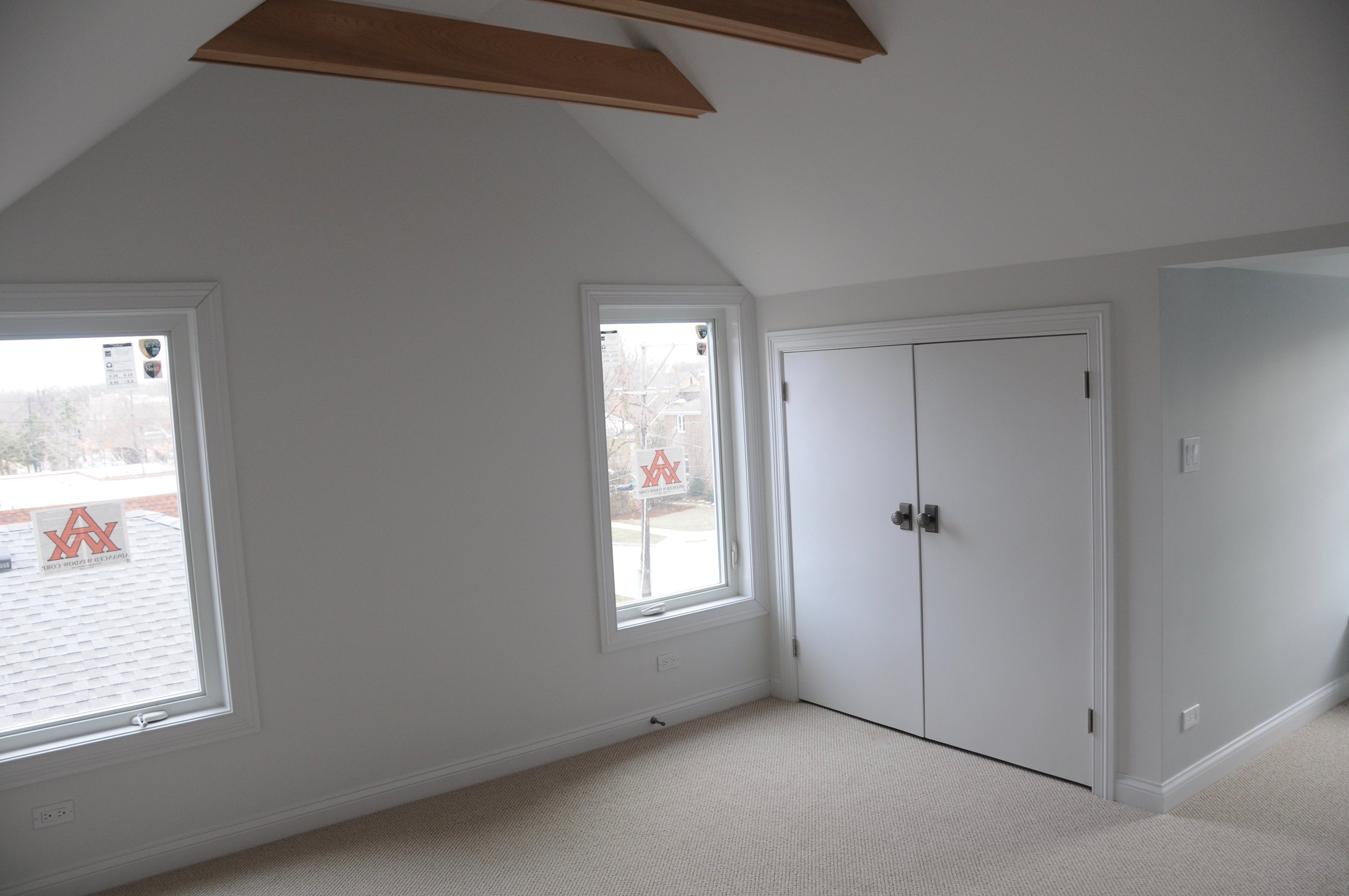The adjacent bedroom with closet and new windows. This room is flooded with light for most of the day and has its own reading bench in the dormer.