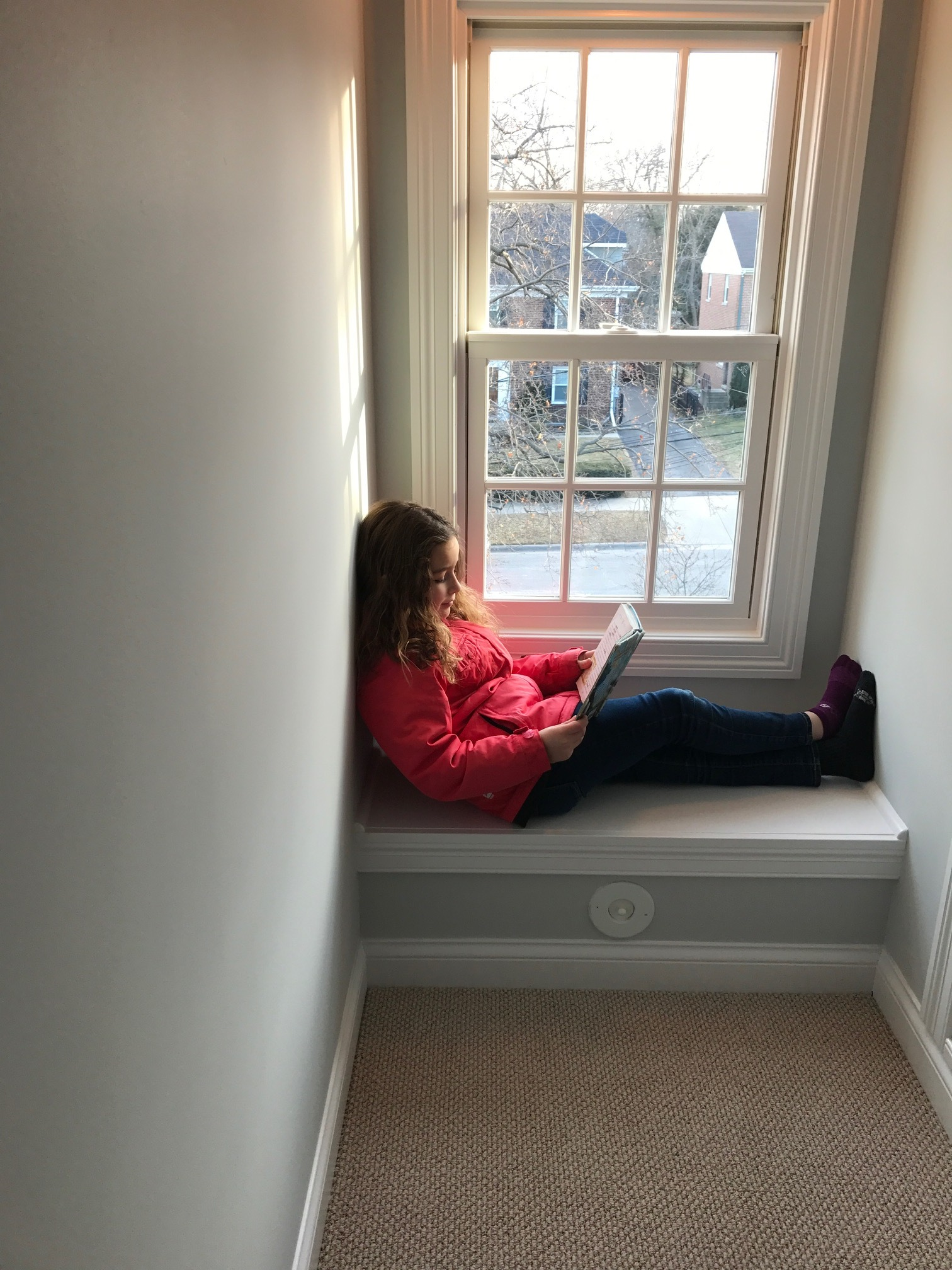 My 8-year old instinctively picked a good spot for reading. It feels a little like discovering buried treasure when I think that this attic was creaky, dark, and poorly insulated for more than 90 years. Sometimes unusual spaces have a purpose waiting to be revealed, or they must be pre-planned in new construction before the architect erases them in the quest for efficient space utilization.