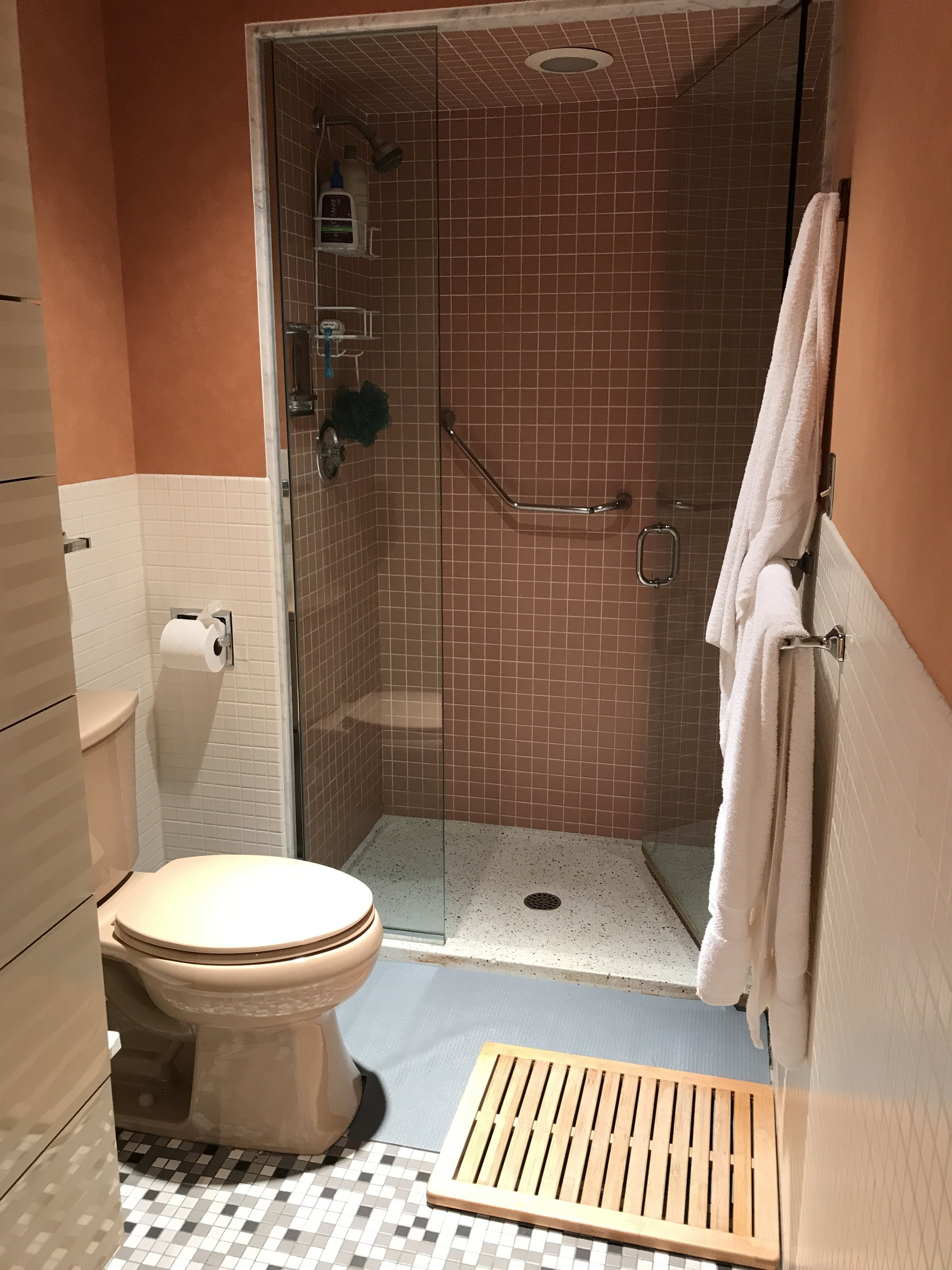 More peach goodness right here, along with different kinds of flooring (but no carpet?!), the small shower, and the mauve toilet.