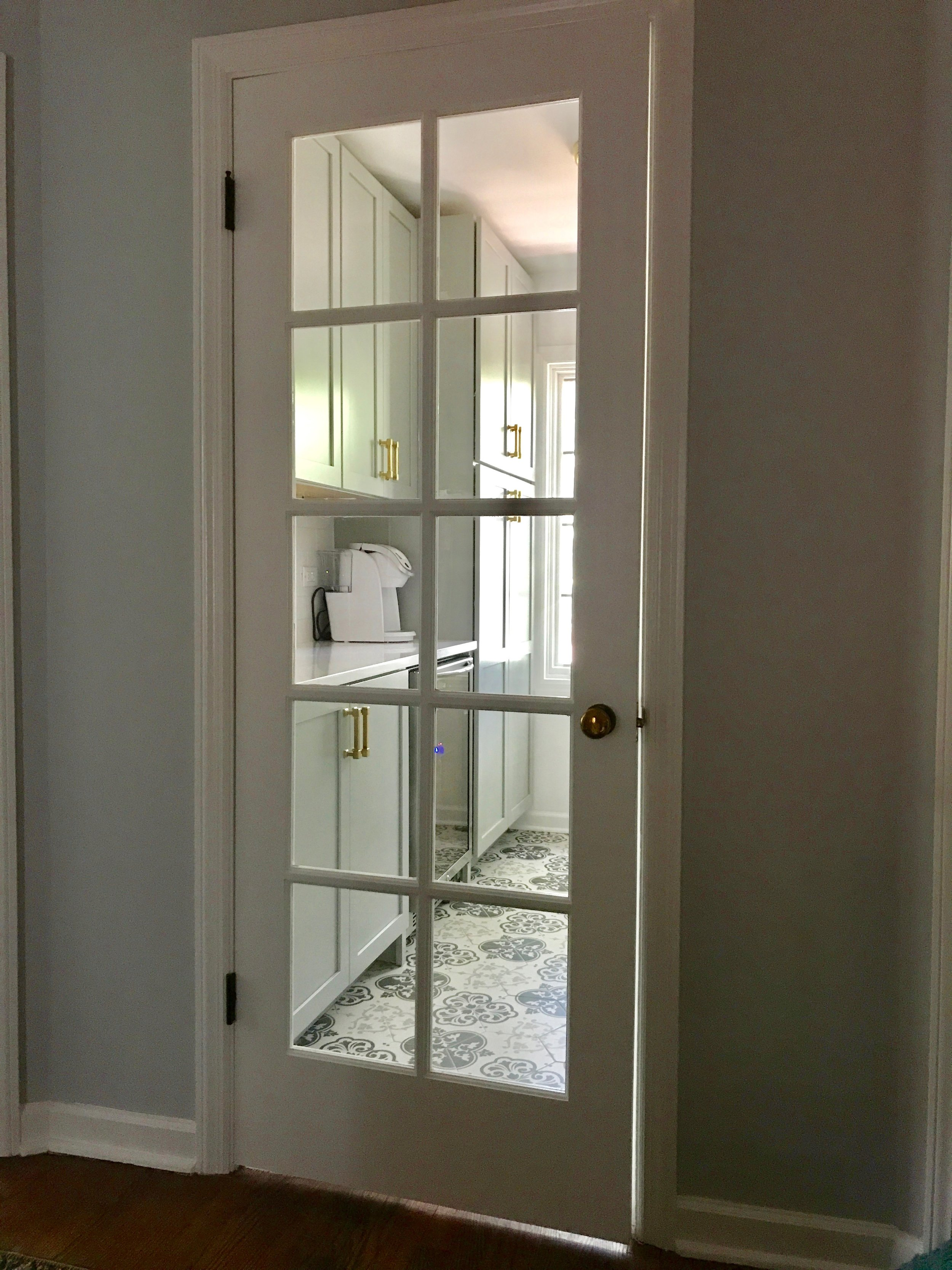 No longer a closed storage room, it was time to reclaim the natural light with a new 10-lite glass door.