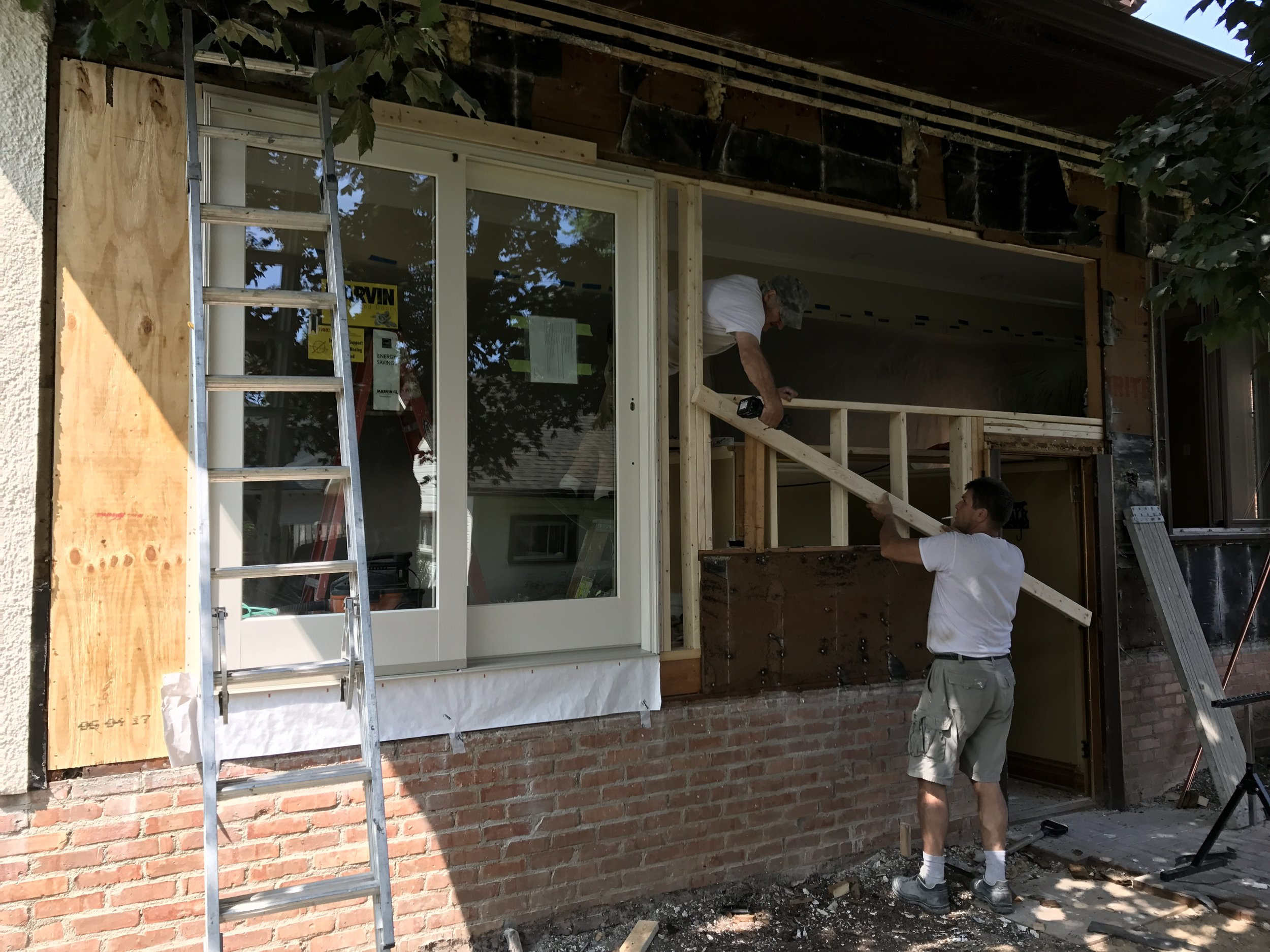 In order to access the deck from the kitchen, we removed a bank of windows and installed a sliding door.