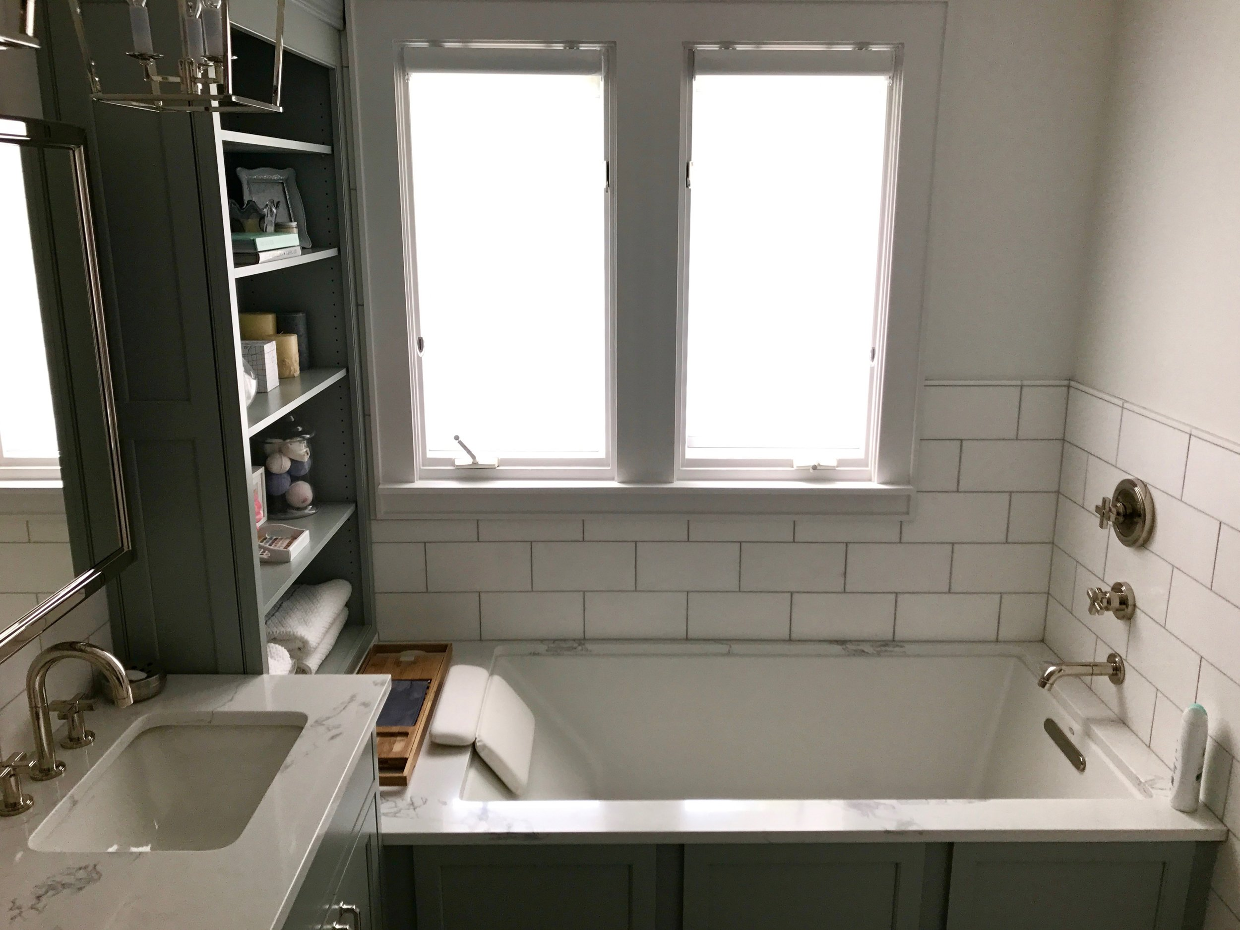 The new tub and functional cabinetry. The country curtains were replaced with light-softening semi-opaque shades.