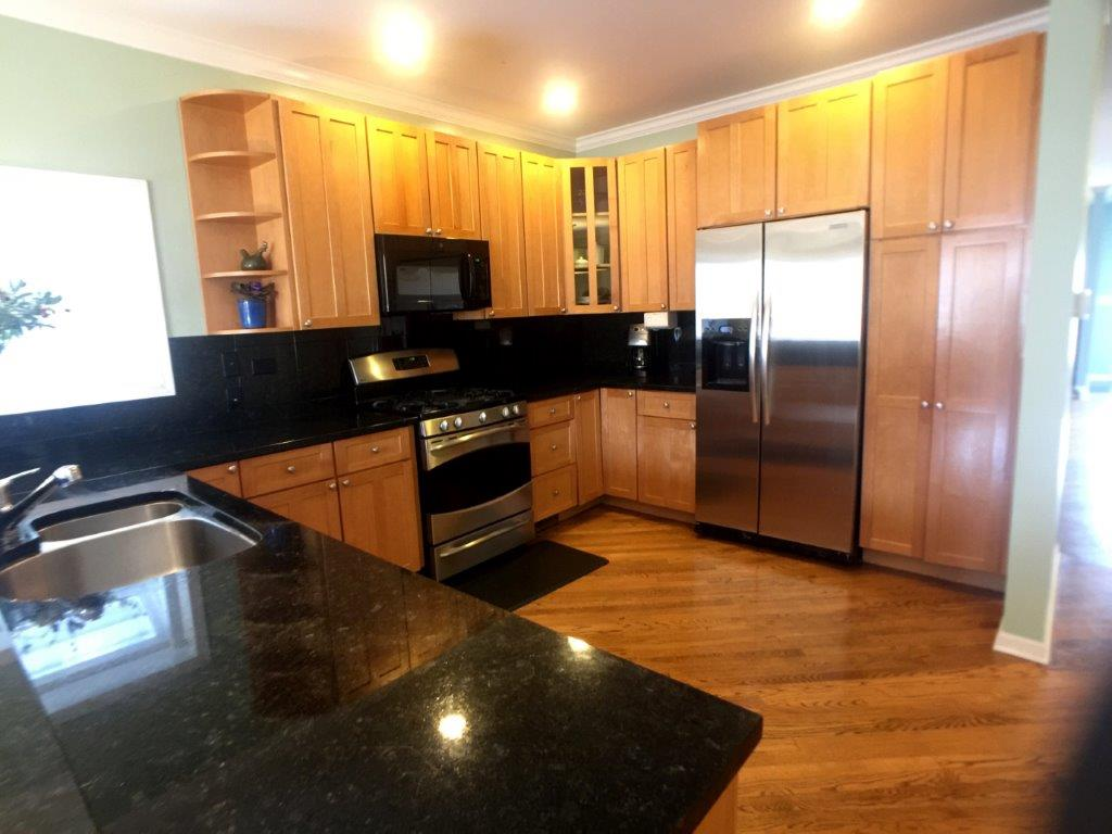 So many kitchens from 1997-2005 featured the same orange-brown maple cabinets, satin nickel hardware, and polished black granite. This was not a great era for kitchens.
