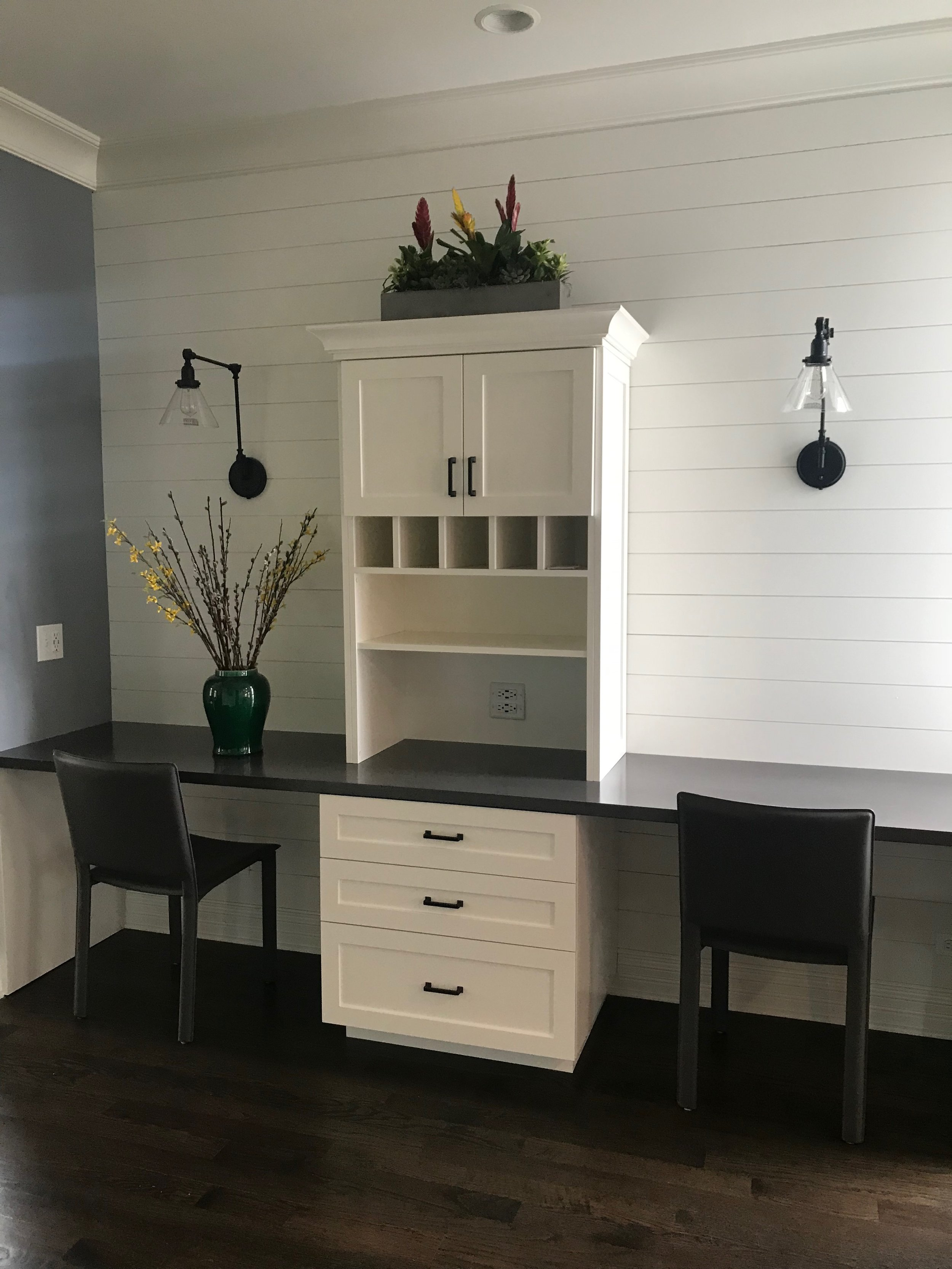 Table for two: a dedicated work space with custom cabinetry and built-in electrical for charging all of the electronic devices in the top drawer. Out of sight and organized in one place.