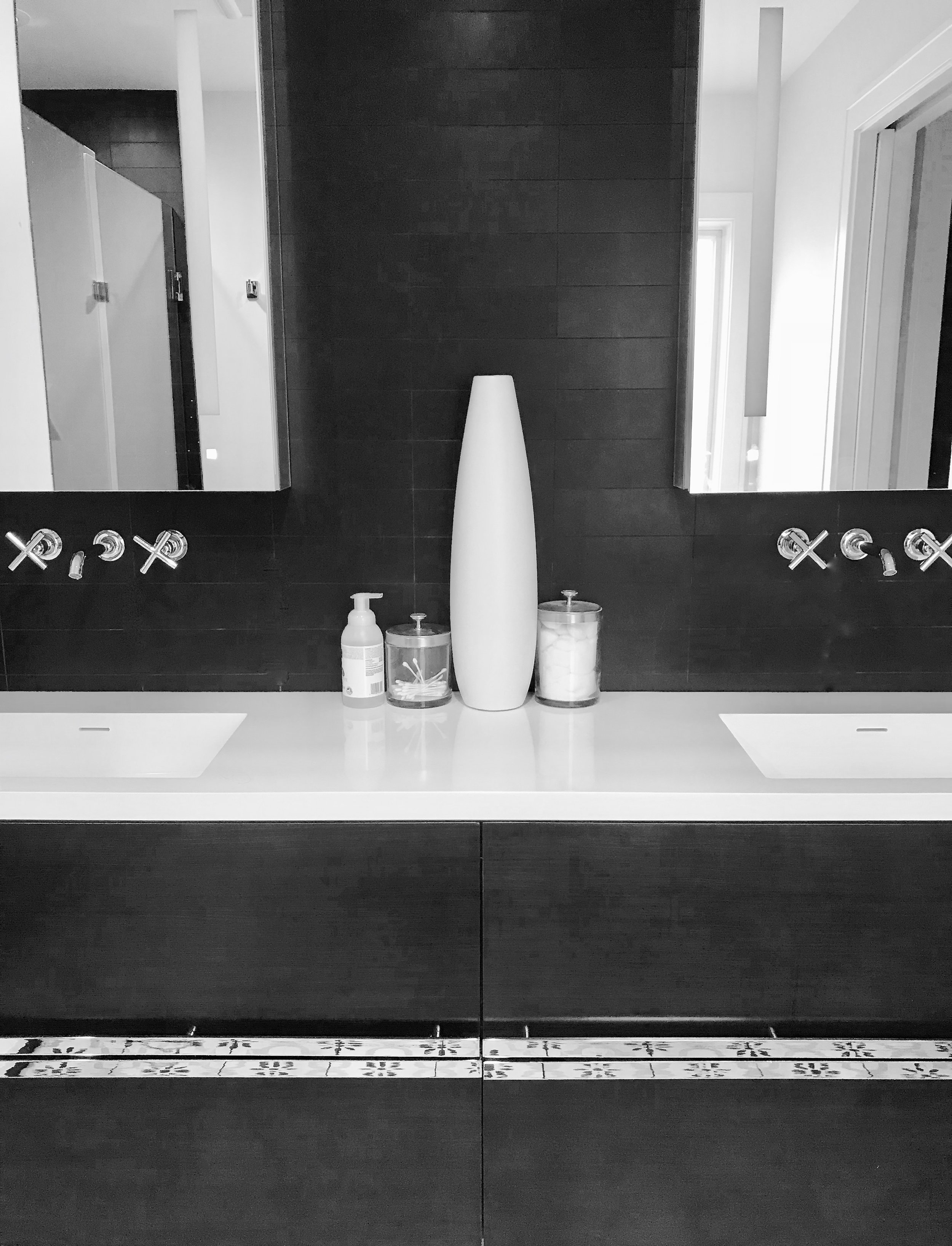 We recently renovated a home with a two-story addition and modern master bathroom. It features a Madeli floating vanity, Robern medicine cabinets, and black basalt tile on the wet wall.