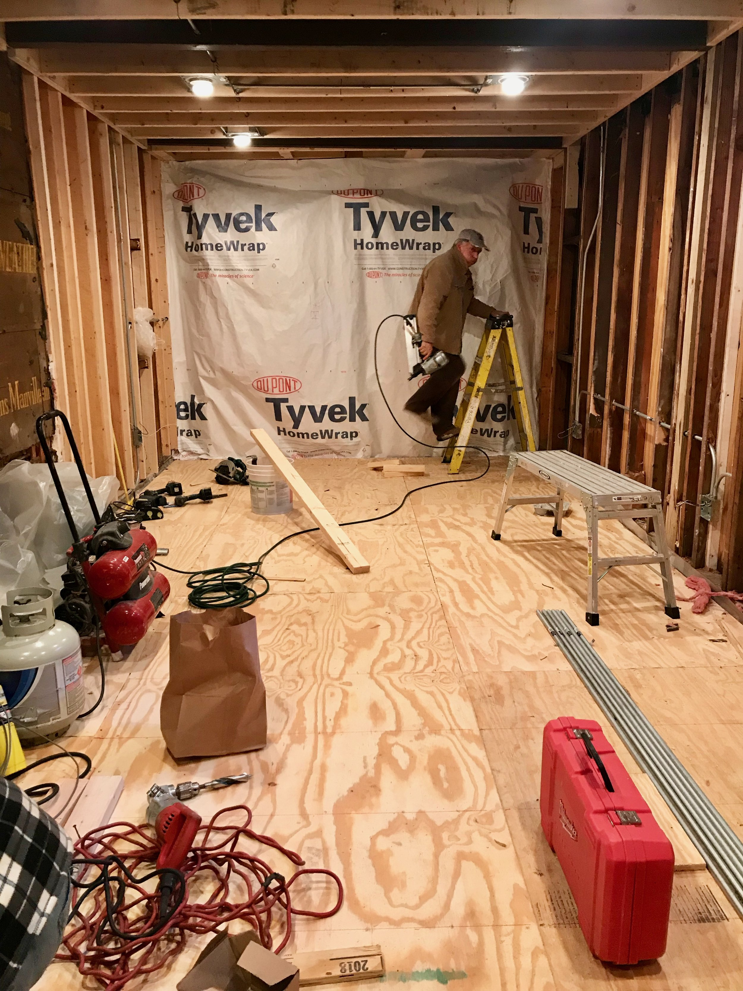 "Under the 3/4"" plywood sub-floor is a vapor barrier, stud platform, and closed cell foam insulation. A minor amount of disassembly and demolition would be required to revert to a functional garage in the future."