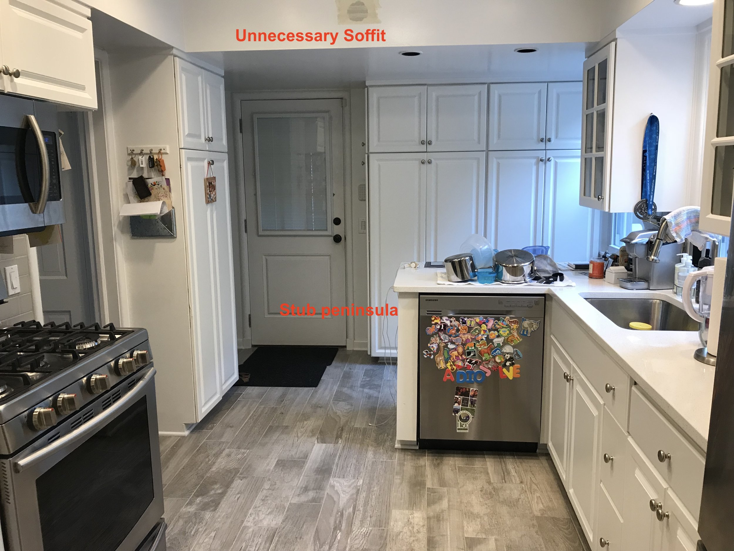 """The original kitchen was poorly designed with an """"L"""" shape peninsula stub to hold the dishwasher."""