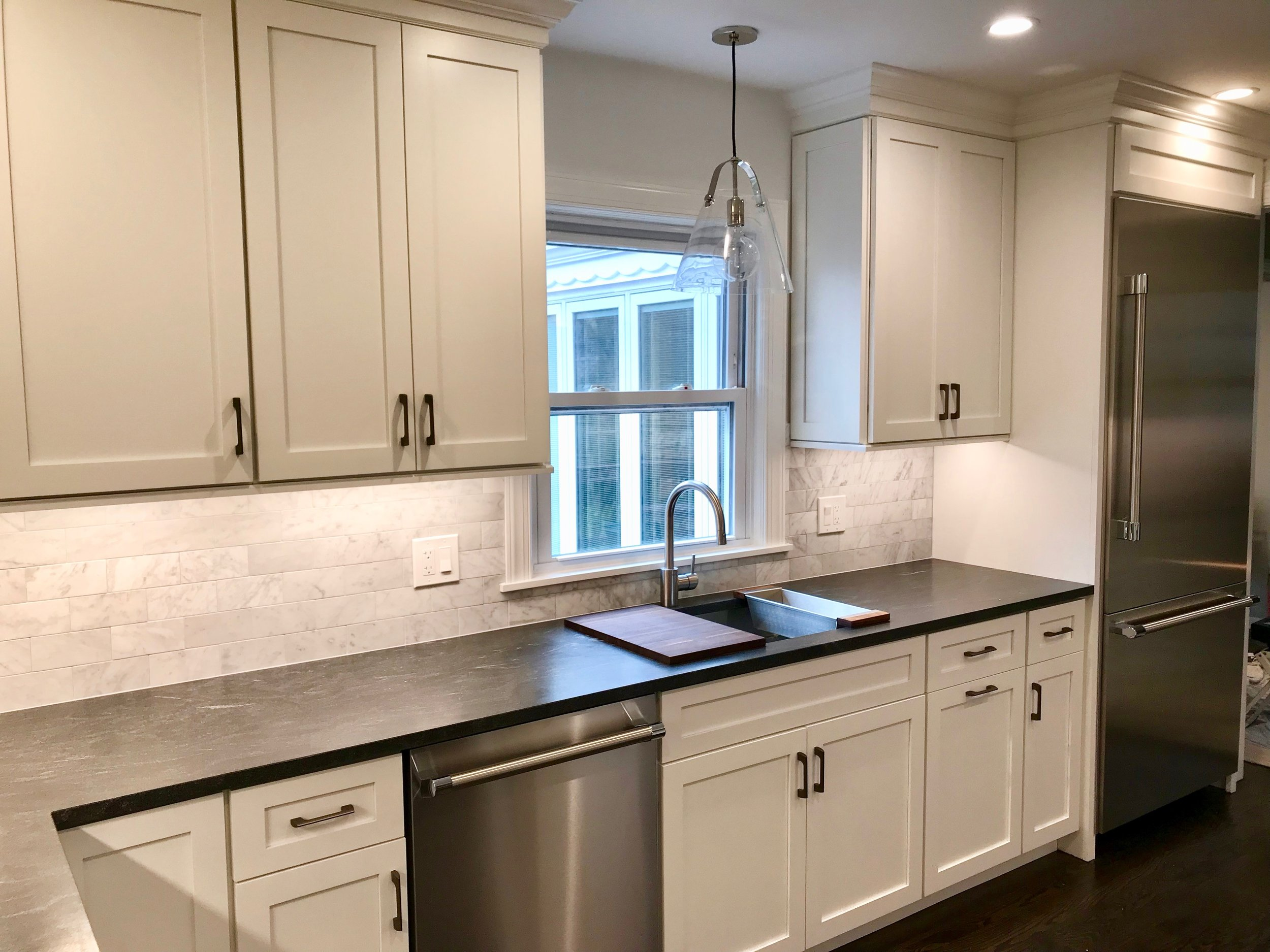 A counter-depth refrigerator is preferable despite the additional cost, especially in a small kitchen.