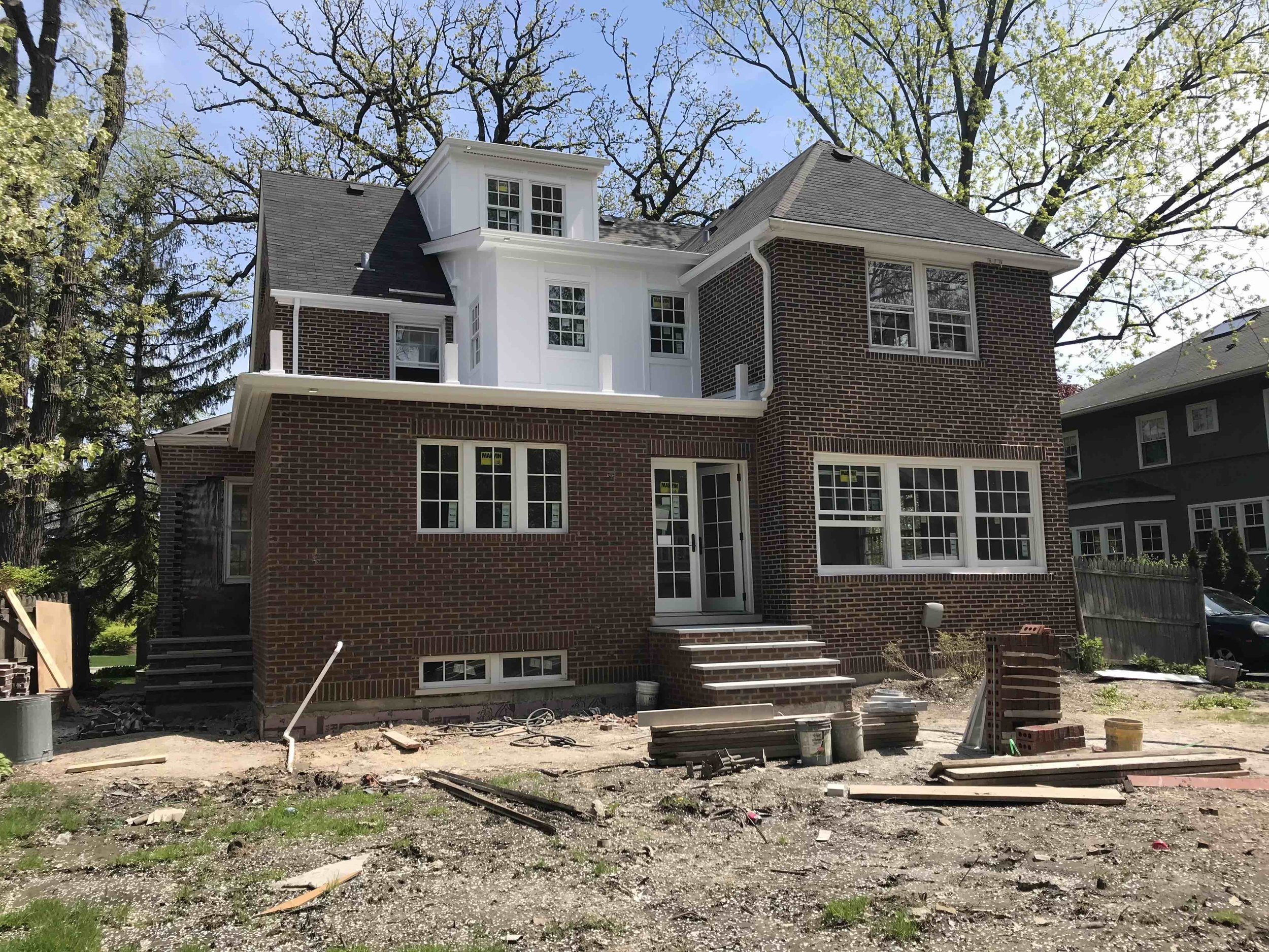 "A renovation of a 1926 colonial in which we excavated the basement, added a kitchen and mudroom above it, and built a second-story laundry room with a third floor dormer to accommodate the new stairs to the attic. This is a typical renovation plan to remake an old home so that it ""lives new"" without tearing it down."