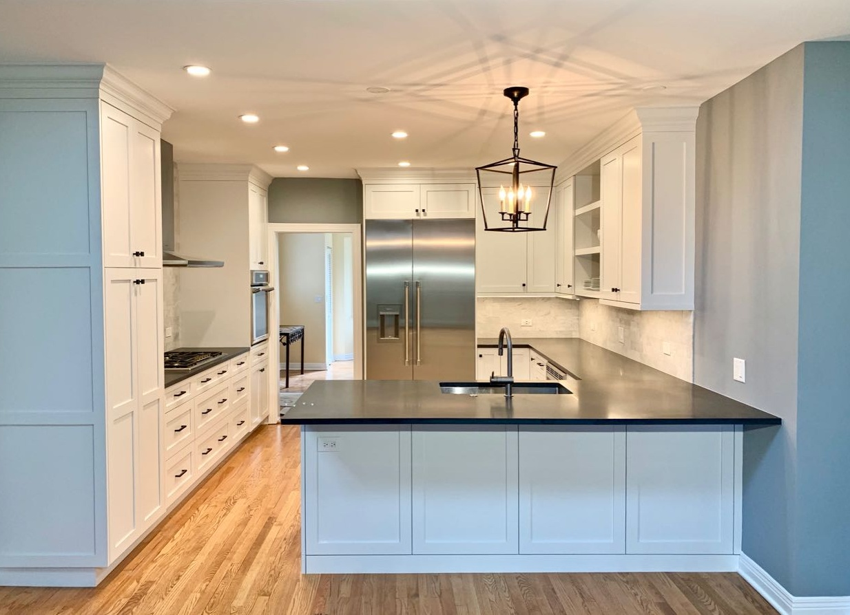 The completed kitchen with custom cabinetry, new appliances, and an extended footprint. One benefit of good quality cabinetry is that it is easier to repair or refinish than cabinetry made with cheaper materials.