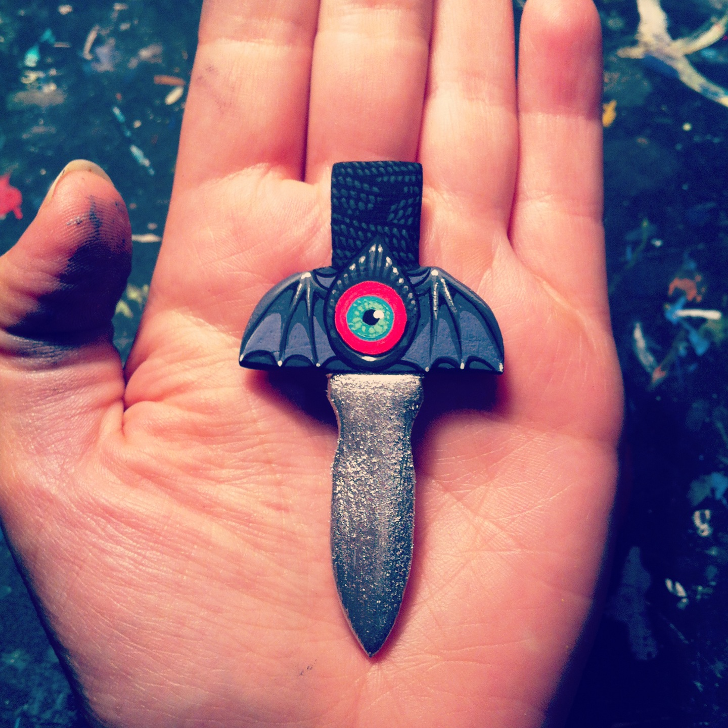 Hand sculpted and painted wooden dagger pin,
