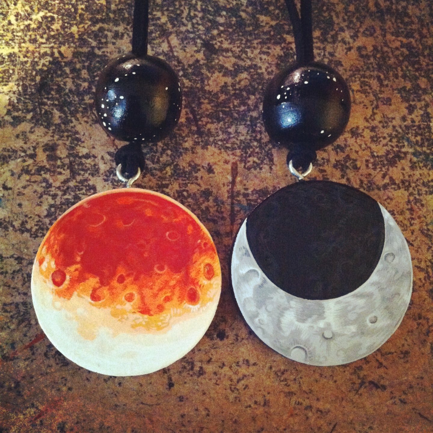 Handpainted wooden eclipse and crescent moon pendants