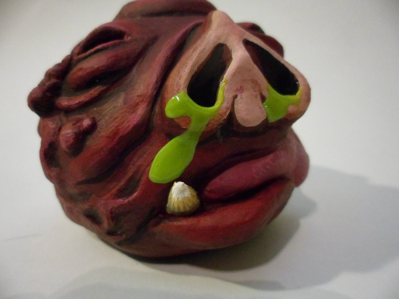 "Custom creature ""madball"" made as a gift using Das paper clay, glue and acrylic paint."