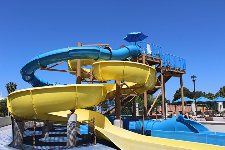 Two Thirty Foot Water Slides - Climb 30 feet to surf two of the most tubular water slides at the Disneyland Resort! The yellow Courtyard Cruiser and the blue Anaheim Accelerator offer thrilling rides down to a splash landing below. Riders must be 40 inches or taller.