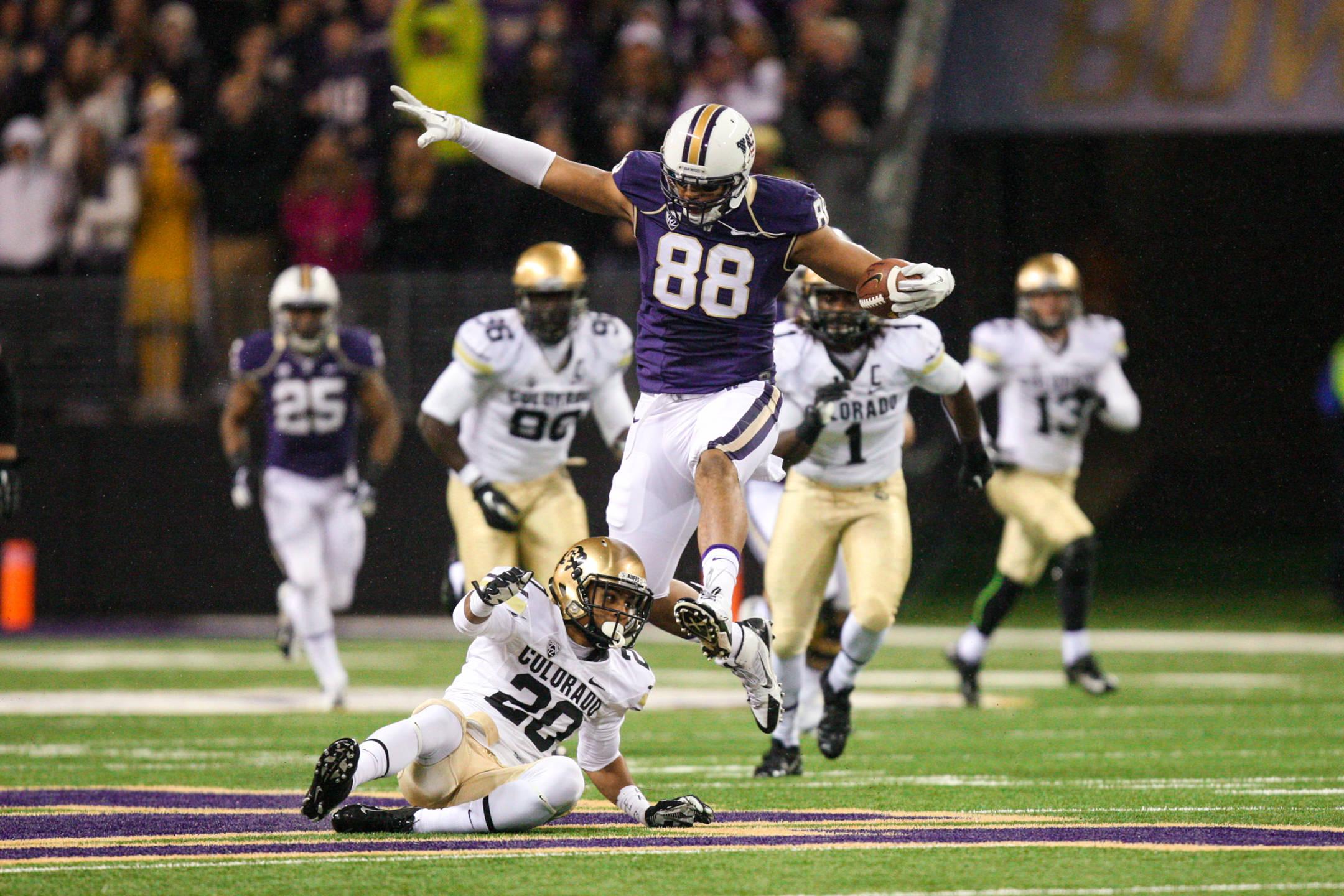 University of Washington Huskies Tight End Austin Seferian-Jenkins Jumping Over Colorado University Buffalos Defender