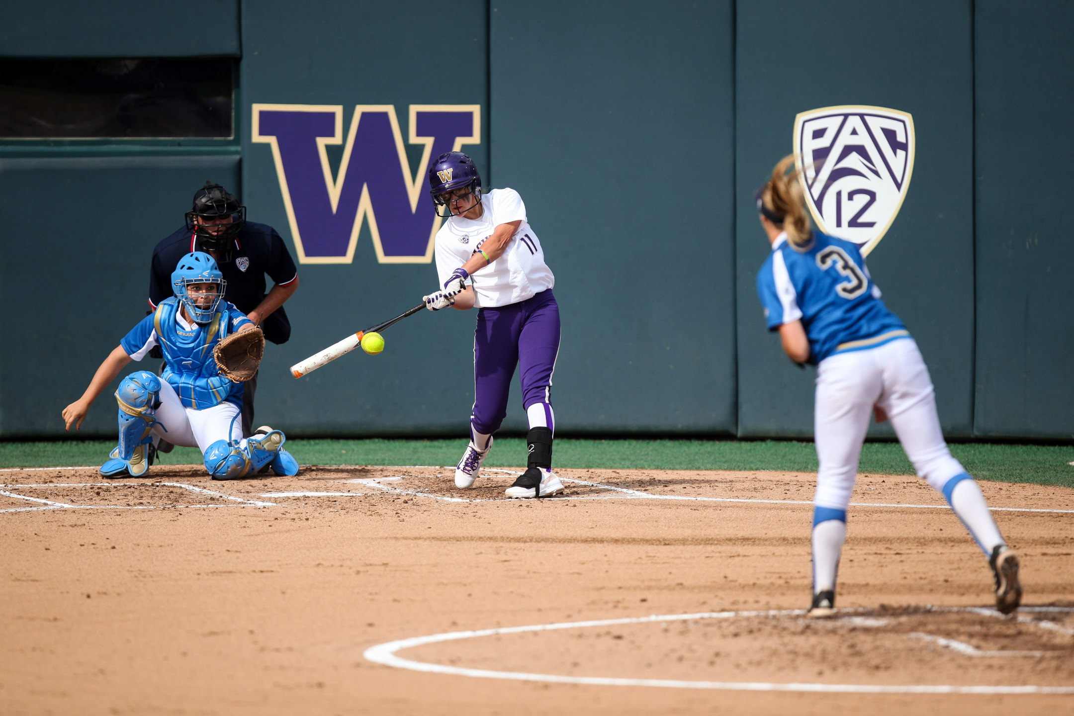 University of Washington Huskies Softball Infielder Kylee Lahners Swings during a match against the UCLA Bruins